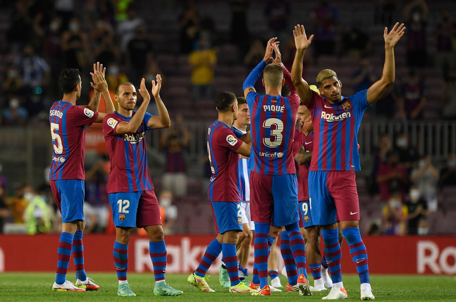 Barcelona players celebrate during a Spanish La Liga match against Real Sociedad at Camp Nou, Barcelona, Spain, Aug. 15, 2021. (AFP Photo)