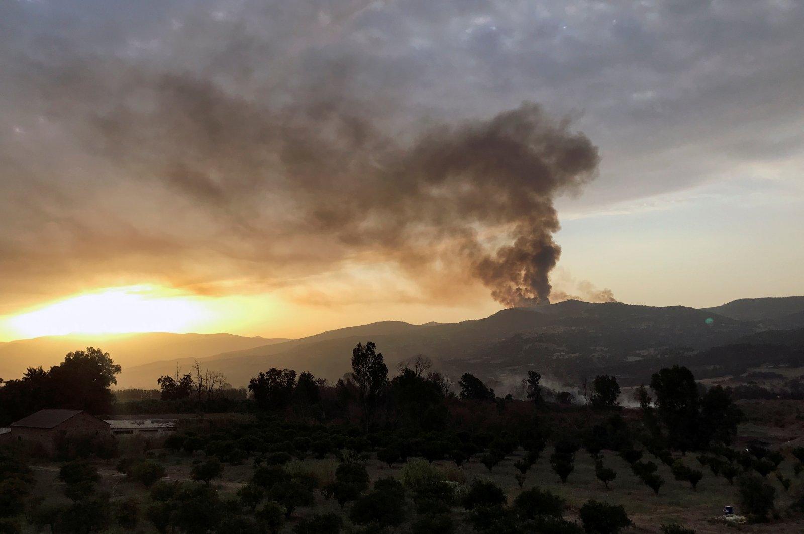 Smoke rises following a wildfire in Bejaia province, Algeria, Aug. 16, 2021. (Reuters Photo)