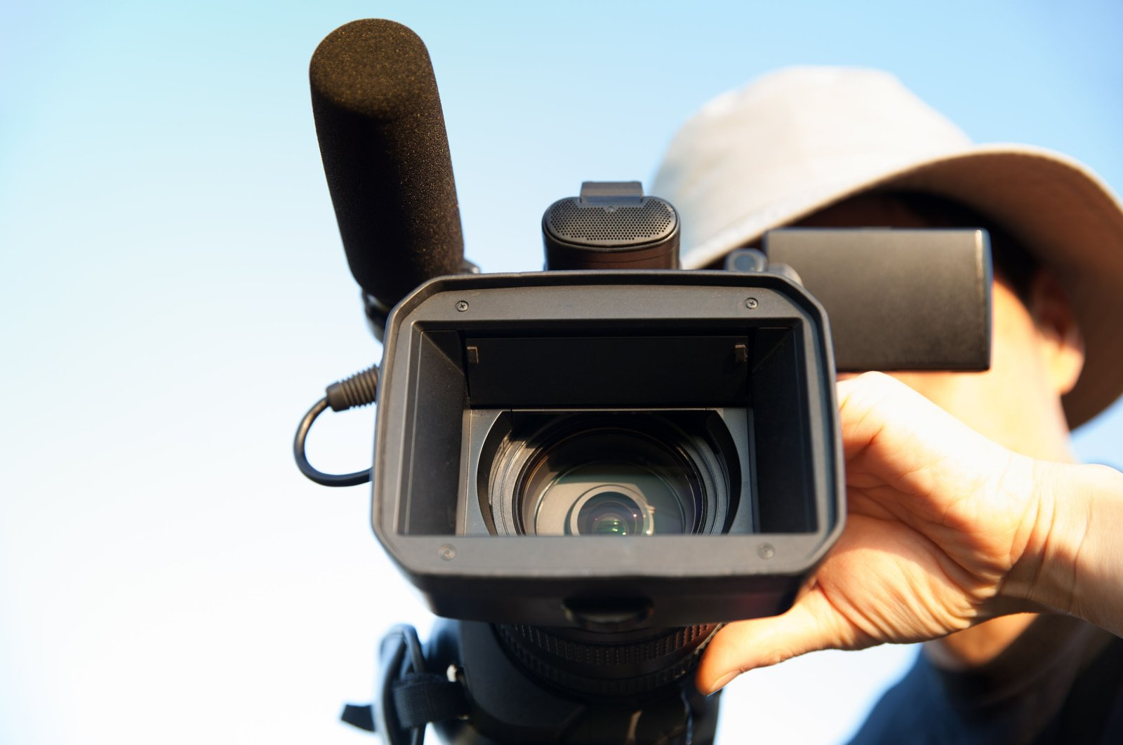 A man films with a camcorder. (Shutterstock Photo)