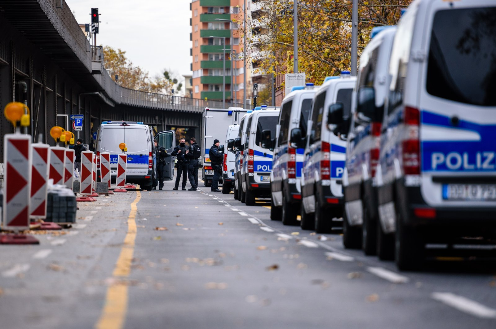 Police cars can be seen on Gitschiner Strasse during raids in which police arrested three suspects, Nov. 17, 2020. (Reuters Photo)