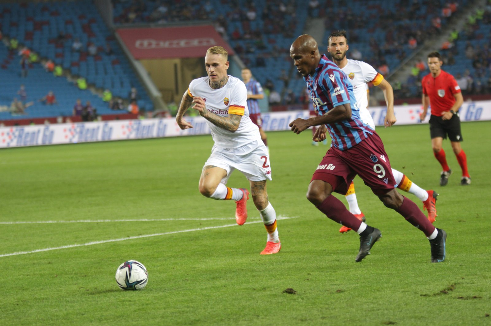 Trabzonspor and AS Roma players are seen in action at Şenol Güneş Sports Complex in Trabzon, Aug. 19, 2021. (IHA Photo)