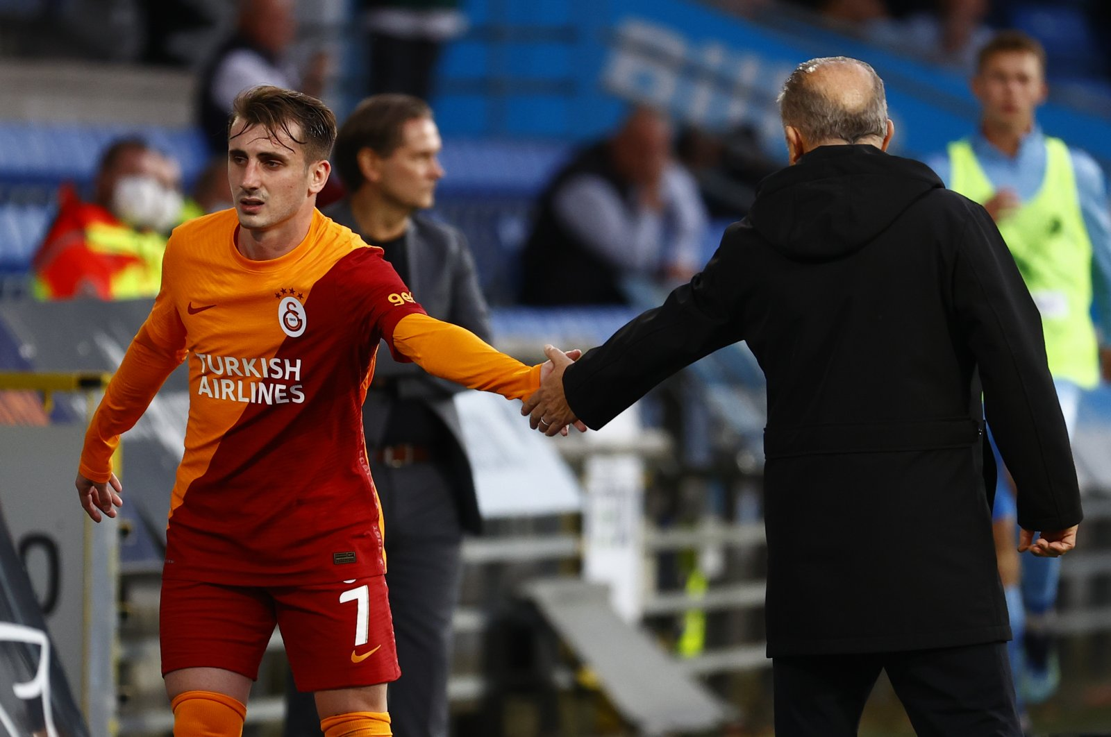 Galatasaray's Kerem Aktürkoğlu shakes coach Fatih Terim's hand after leaving the pitch at the Randers Stadion in Denmark during the UEFA Europa League playoff match against Randers on Aug. 19, 2021 (AA Photo)