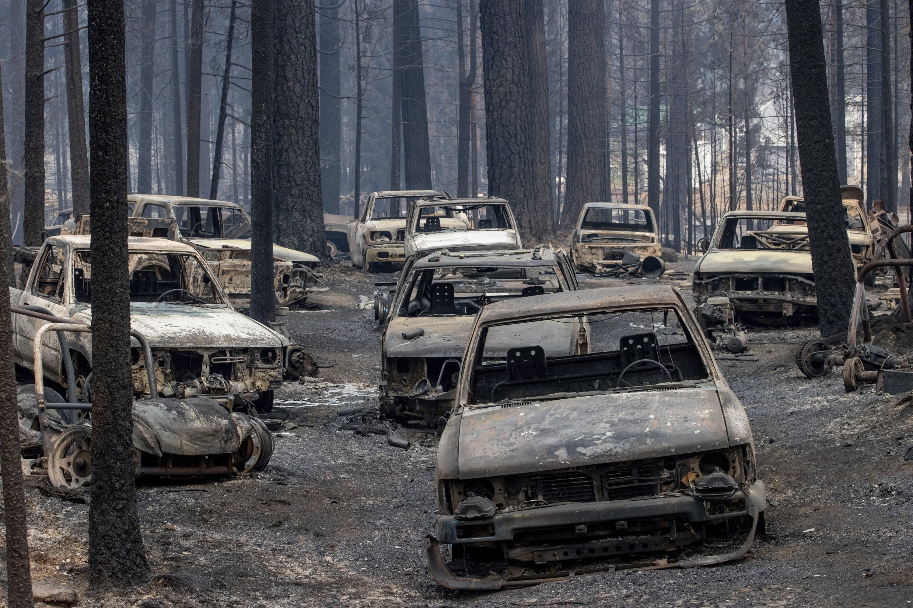 Scorched vehicles destroyed by the Caldor fire rest on Evergreen Drive in Grizzly Flats, California, U.S., Aug. 17, 2021. (AP Photo)