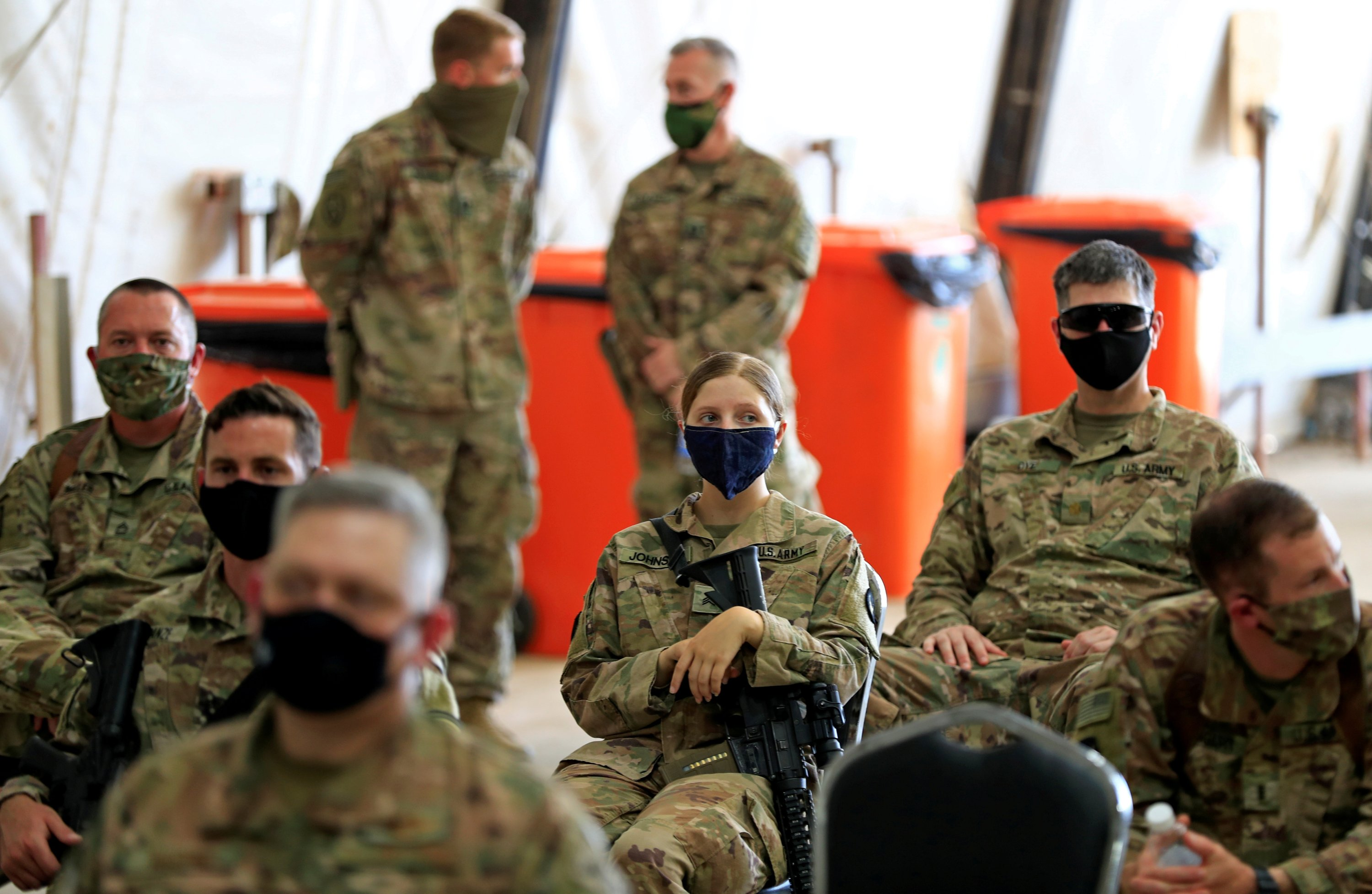 U.S. soldiers wearing protective masks are seen during a handover ceremony of Taji military base from U.S.-led coalition troops to Iraqi security forces, in the base north of Baghdad, Iraq, Aug. 23, 2020. (REUTERS Photo)