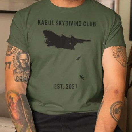 A screenshot from the website tshirtatlowprice.com shows a model wearing a T-shirt depicting Afghans who fell from a United Statesplane at Kabul Hamid Karzai International Airport.