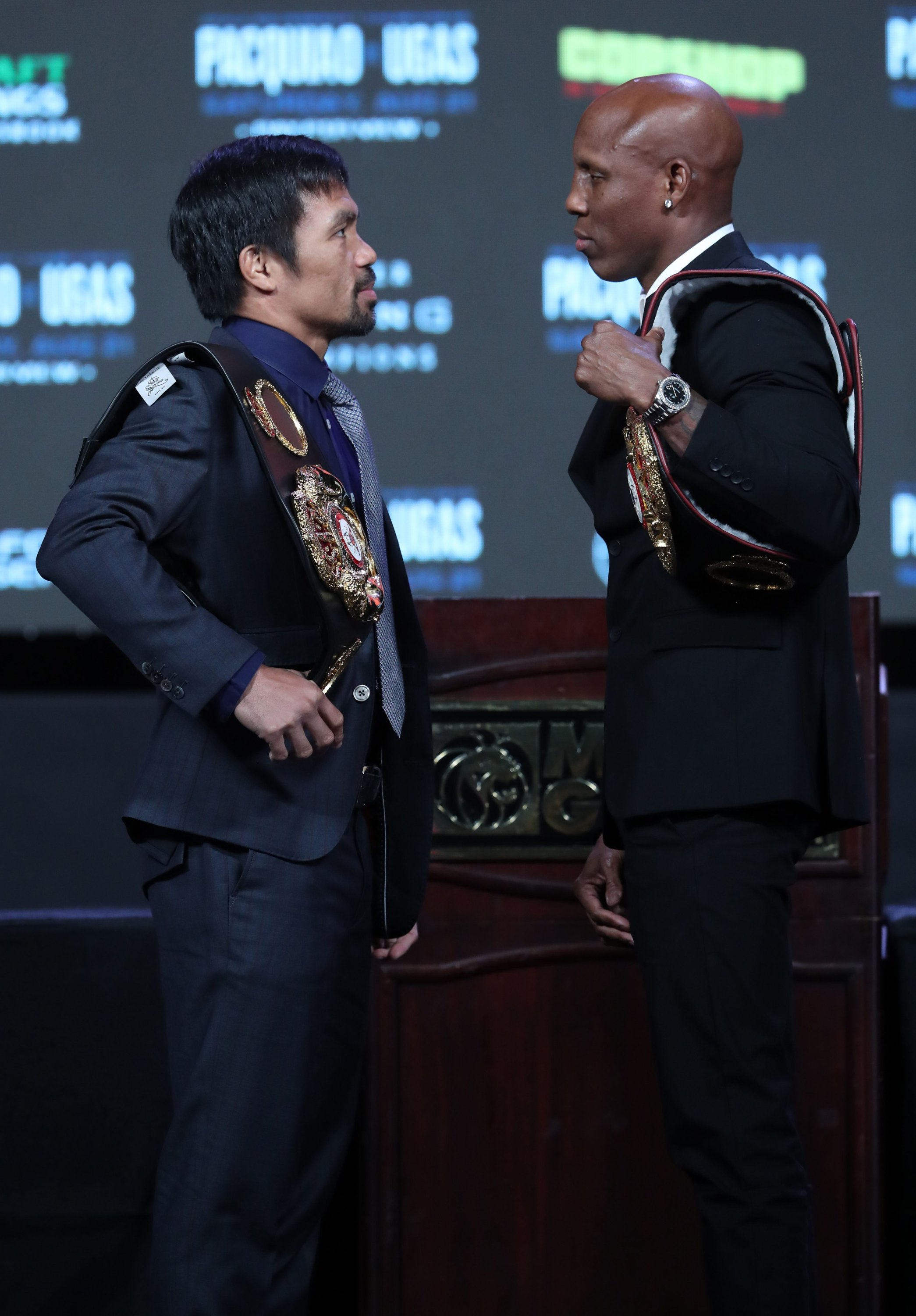 Manny Pacquiao (L) and WBA welterweight champion Yordenis Ugas face off during a news conference at MGM Grand Hotel & Casino, in Las Vegas, Nevada, U.S., Aug. 18, 2021. (AFP Photo)