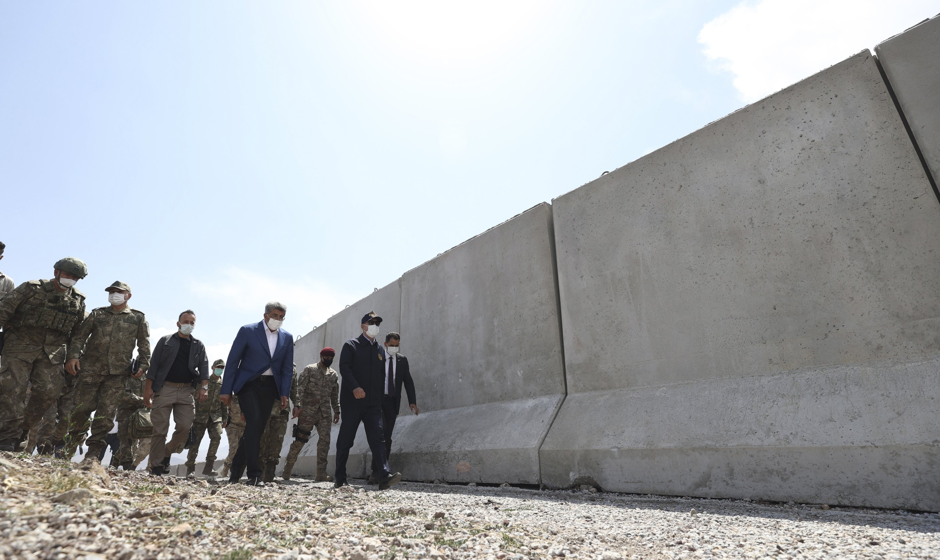 Defense Minister Hulusi Akar (R) and top army commanders check the Turkey-Iran border in Van, eastern Turkey, Aug. 15, 2021. (Turkish Defense Ministry via AP, Pool)