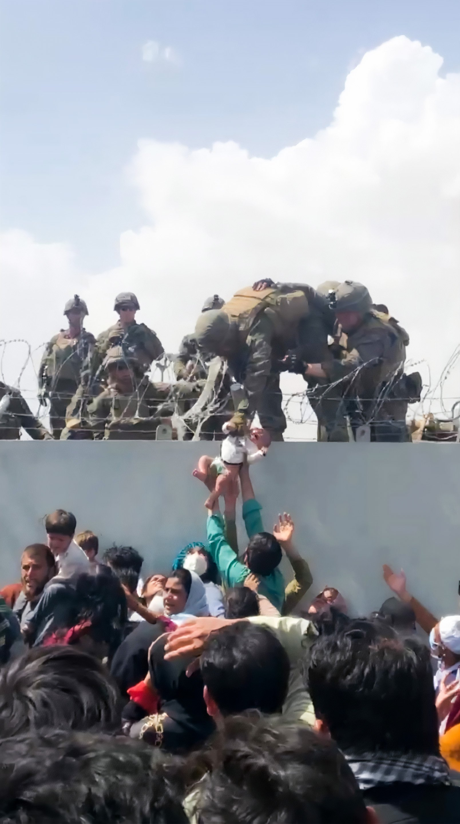 A baby is handed over to the American army over the perimeter wall of the airport for it to be evacuated, in Kabul, Afghanistan, August 19, 2021. (Reuters Photo)