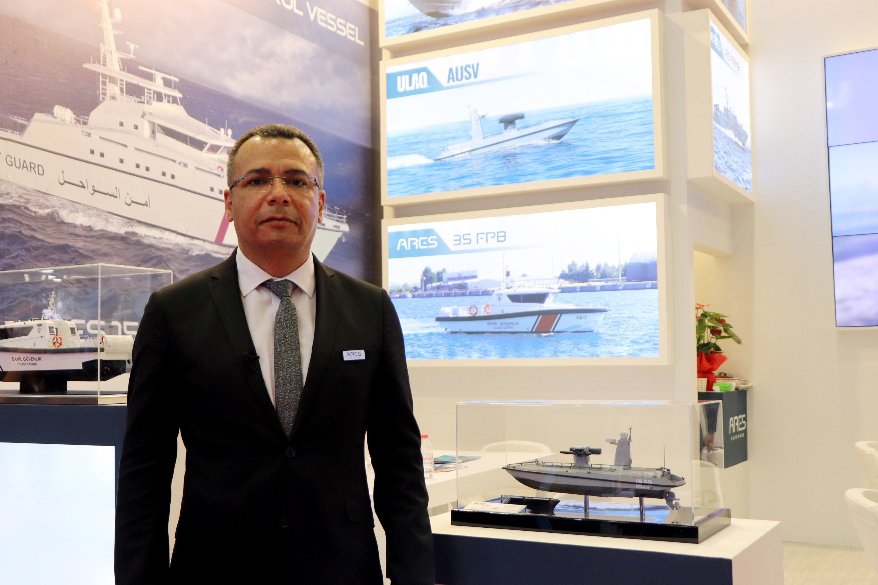Ares Shipyard General Manager Utku Alanç poses for an interview at the IDEF, Istanbul, Turkey, Aug. 20, 2021. (AA Photo)
