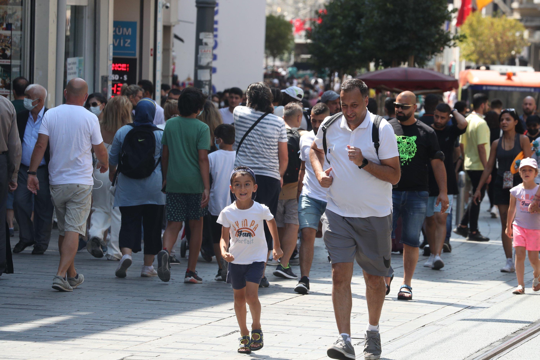 Pedestrians walk on Istiklal Street, the main shopping street in Istanbul, Turkey, July 23, 2021. (DHA Photo)