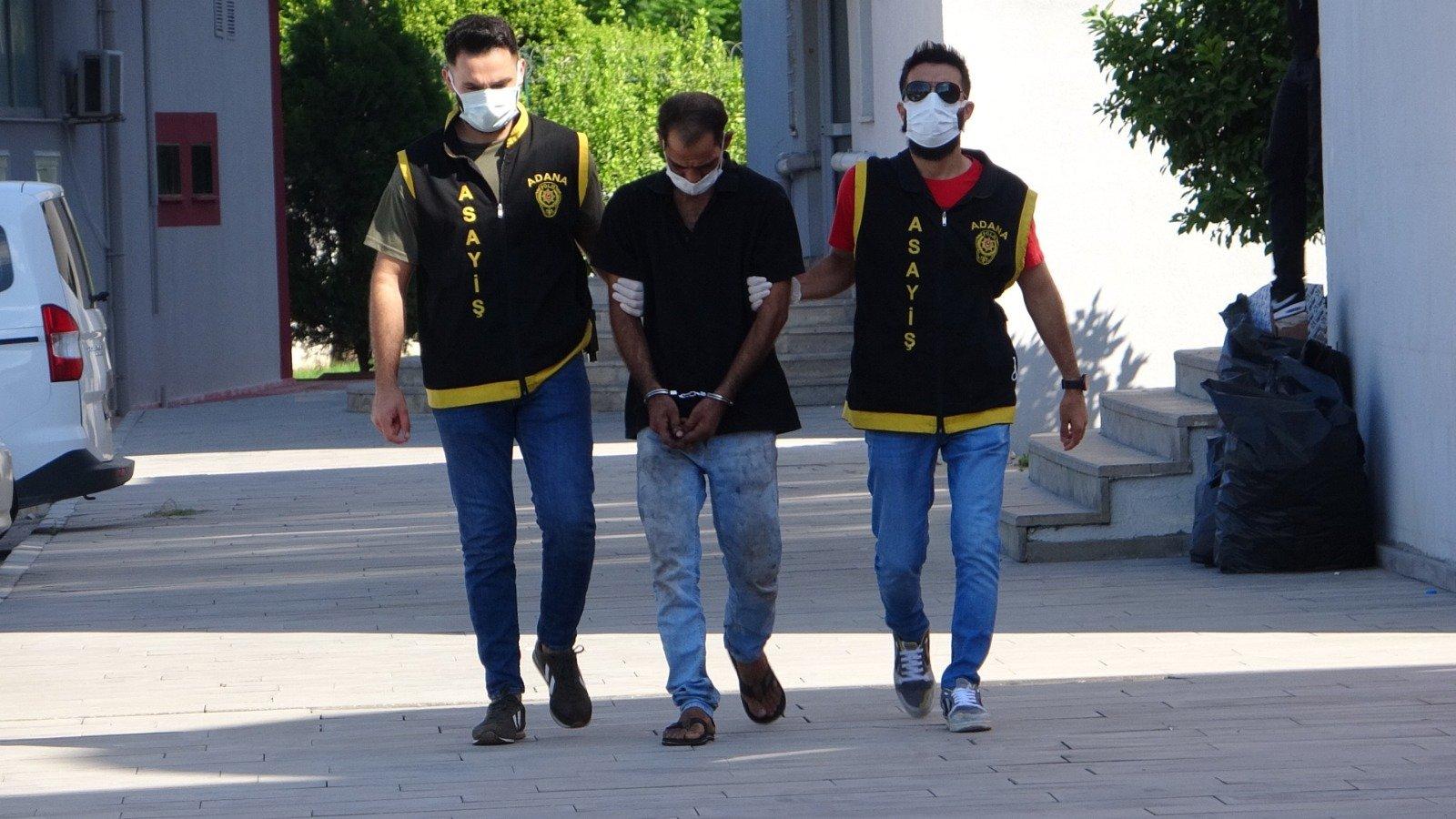 Police escort suspected car thief C.A. in Adana, southern Turkey, Aug. 20, 2021. (Photo by Ziya Ramoğlu)