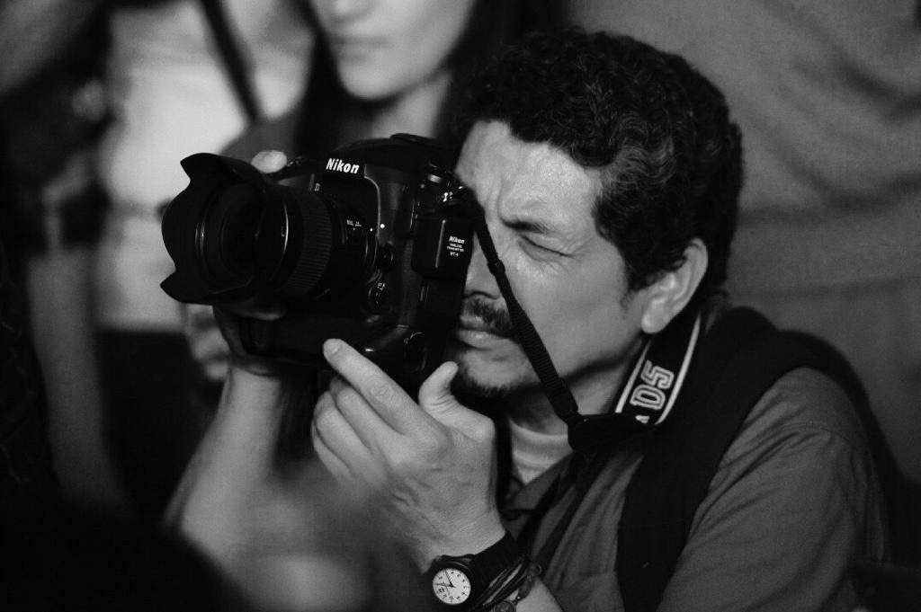 AFP photojournalist Yuri Cortez poses with his camera. (AA Photo)