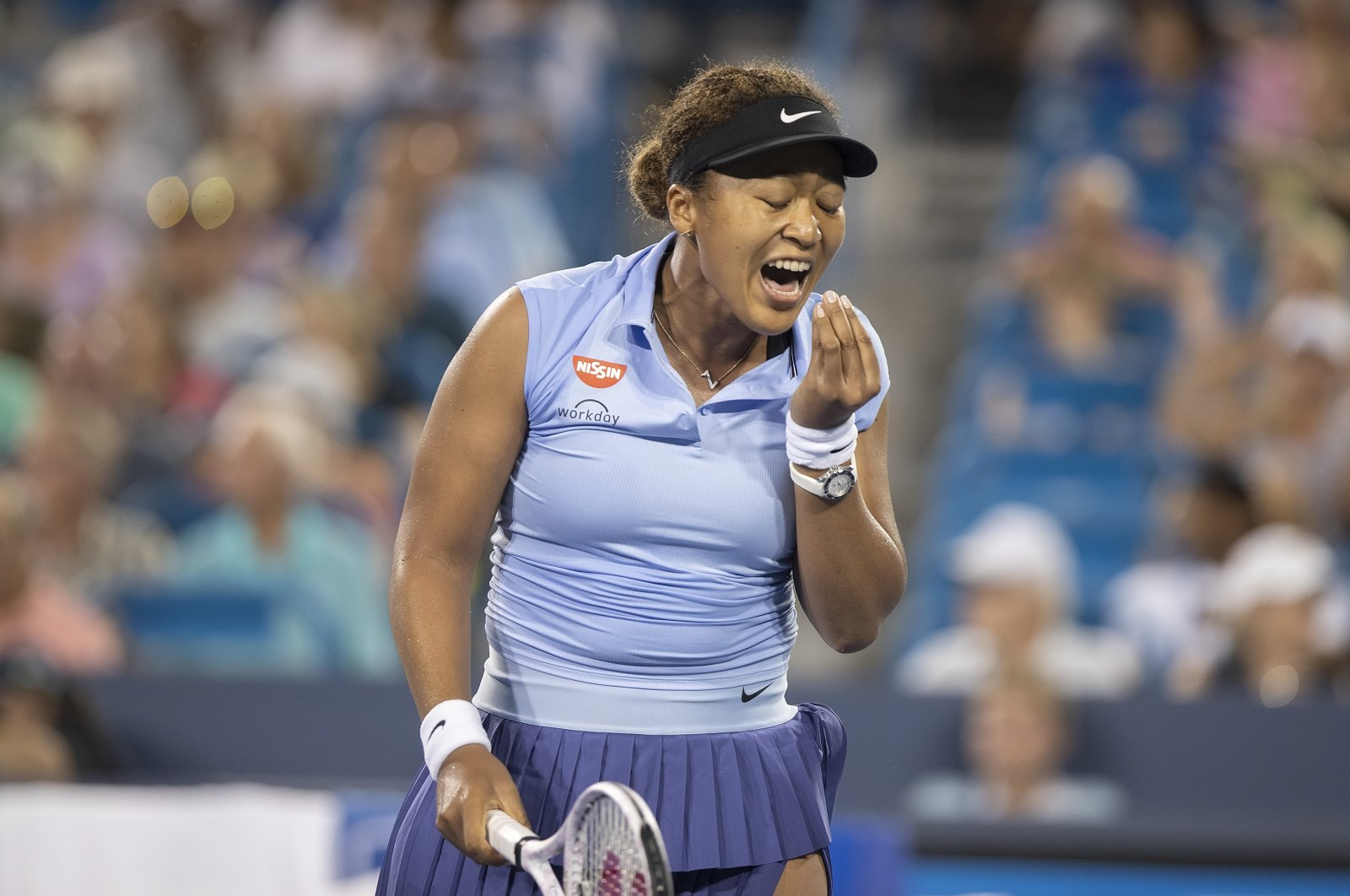 Japan's Naomi Osaka reacts during a Cincinnati Masters third-round match against Switzerland's Jil Teichmann at the Lindner Family Tennis Center, Mason, Ohio, USA, Aug 19, 2021. (Reuters Photo)