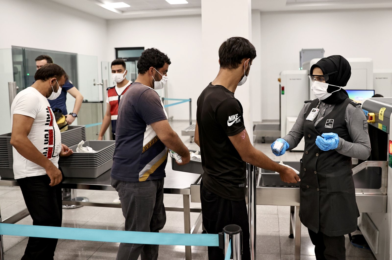 Irregular migrants referred to repatriation centers are sent to Istanbul Airport, Turkey, Aug. 14, 2021. (AA Photo)