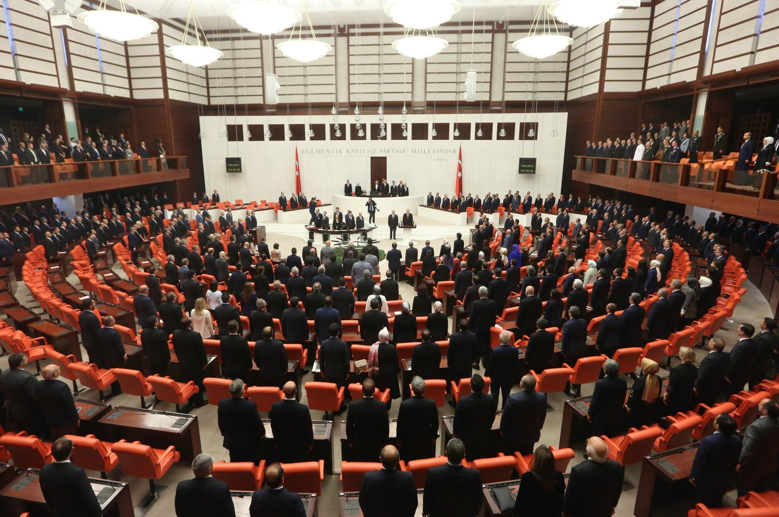 Turkish President Recep Tayyip Erdoğan (C) takes an oath of office before lawmakers under a new system of government at the Grand National Assembly in Ankara, Turkey, July 9, 2018. (Getty Images Photo)