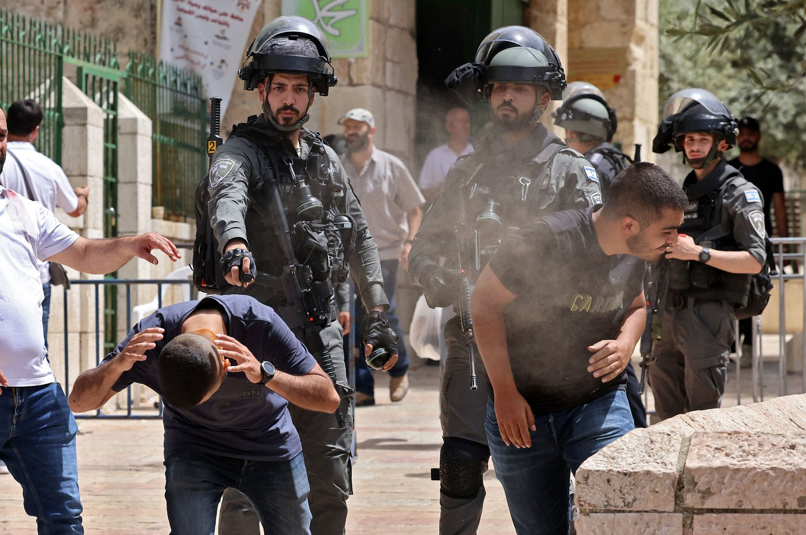 Israeli security forces spray Palestinian protesters in Jerusalem's Old City on May 10, 2021, as a planned march marking Israel's 1967 takeover of the holy city threatened to further inflame tensions. (AFP Photo)