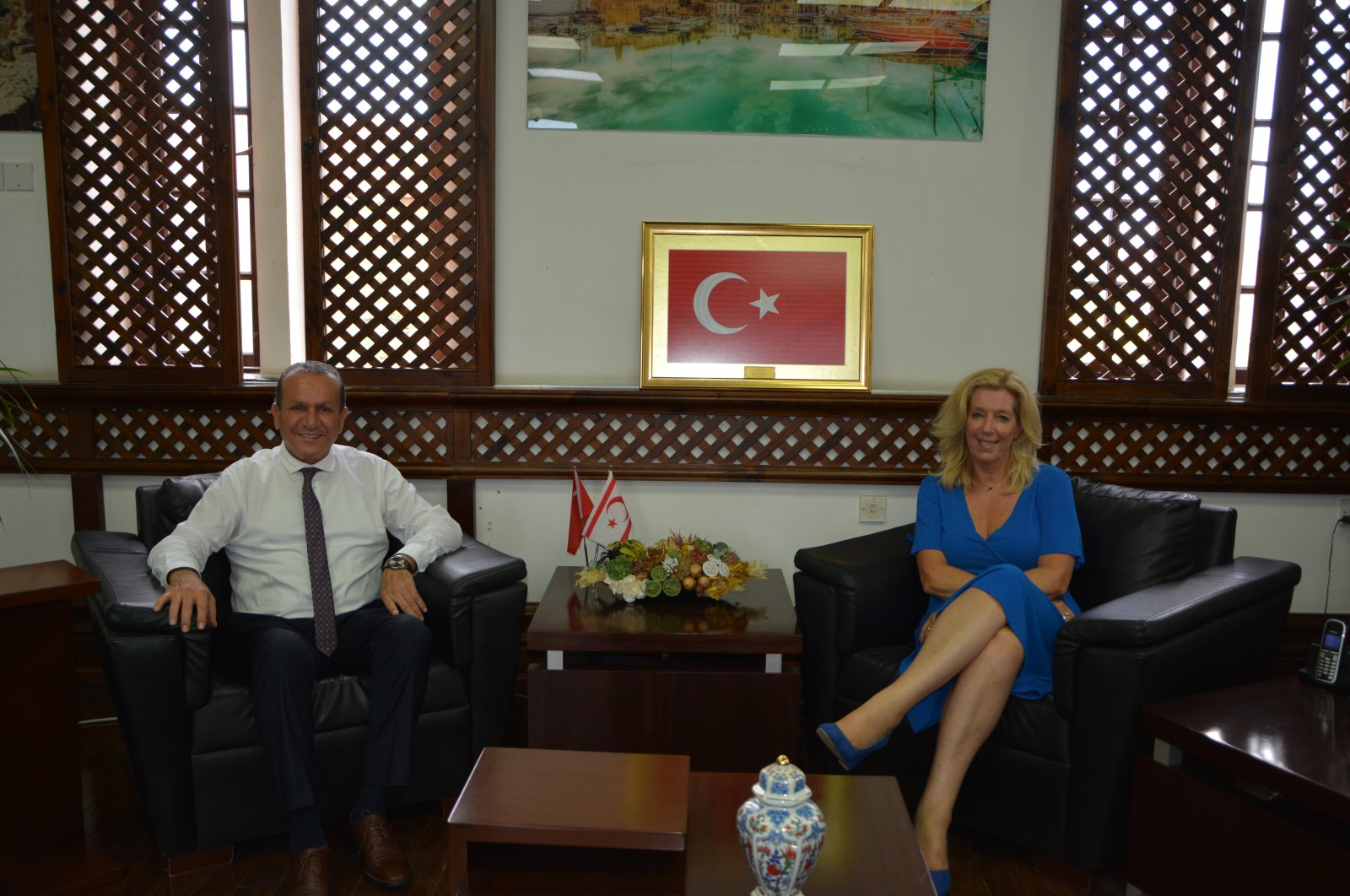Turkish Cyprus' Tourism Minister Fikri Ataoğlu (L) meets with Dutch lawmaker Liane den Haan in Lefkoşa (Nicosia), TRNC, Aug. 16, 2021. (AA Photo)