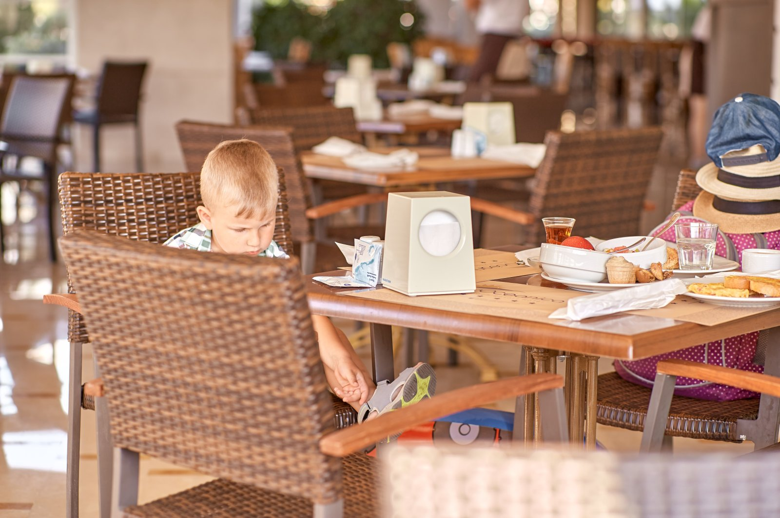 A child eats breakfast at a restaurant in Kemer, in Antalya, southern Turkey, May 21, 2021. (Shutterstock Photo)