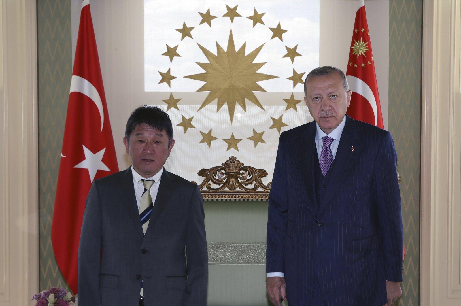 Turkey's President Recep Tayyip Erdoğan (R) and Japan's Foreign Minister Toshimitsu Motegi pose for photos before a meeting, in Istanbul, Turkey, Aug. 20, 2021. (Turkish Presidency via AP)