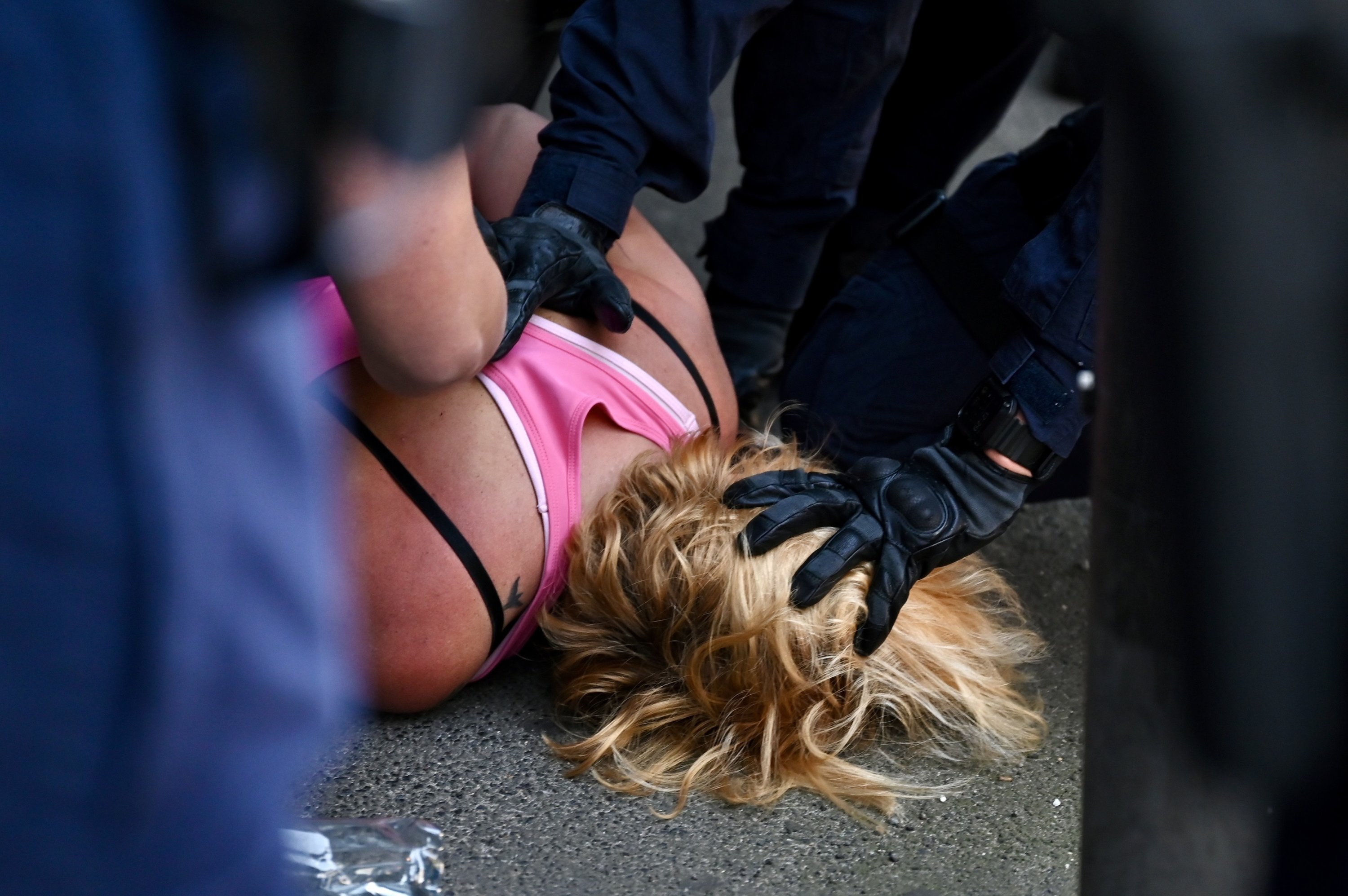 A protester is arrested by police during the 'National Rally for Peace, Freedom and Human Rights' anti-lockdown protest in Sydney, Australia, Aug. 21, 2021. (EPA Photo)