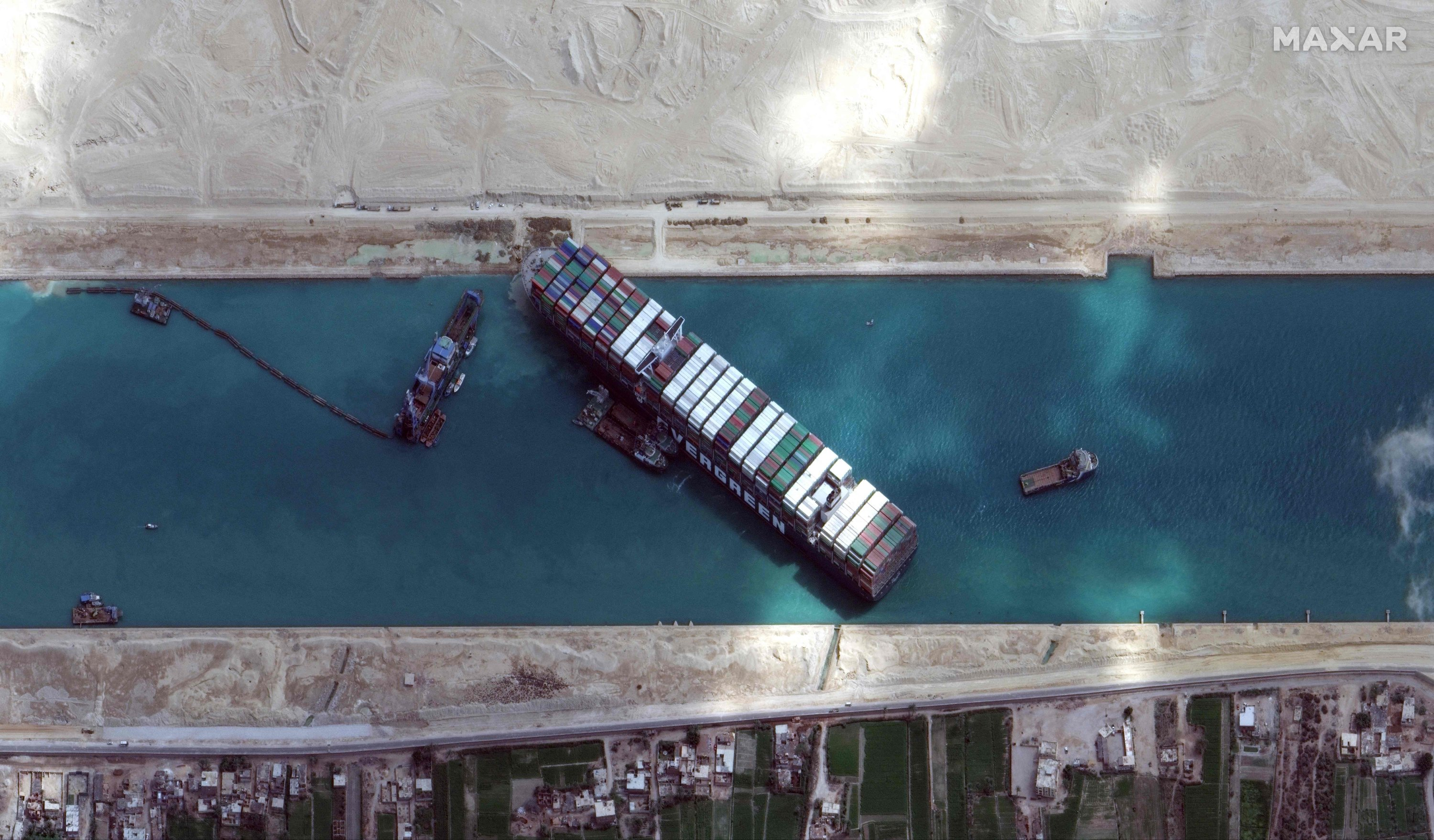 This file satellite imagery released by Maxar Technologies shows the MV Ever Given container ship wedged in the Suez Canal on the morning of March 28, 2021. (AFP Photo / Satellite image 2021 Maxar Technologies)