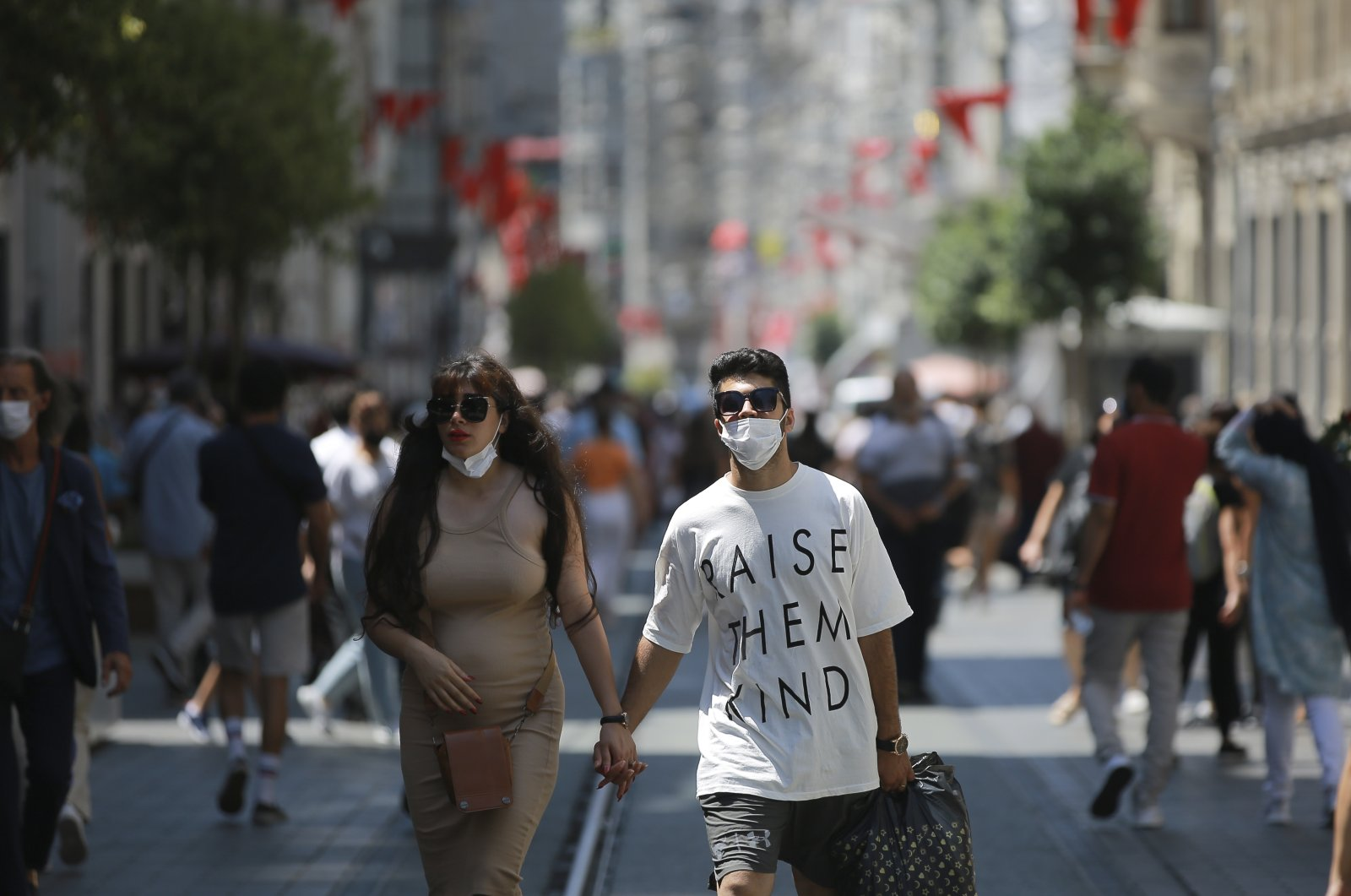 People walk along Istiklal Street, the main shopping street in Istanbul, Turkey, Tuesday, July 27, 2021. (AP Photo)
