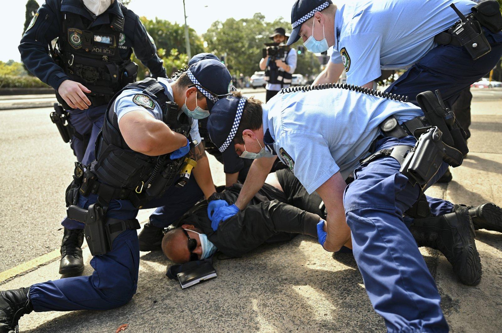 Police arrest a man during an anti-lockdown protest in Sydney, Australia, Saturday, Aug. 21, 2021. (Steven Saphore/AAP Image via AP)