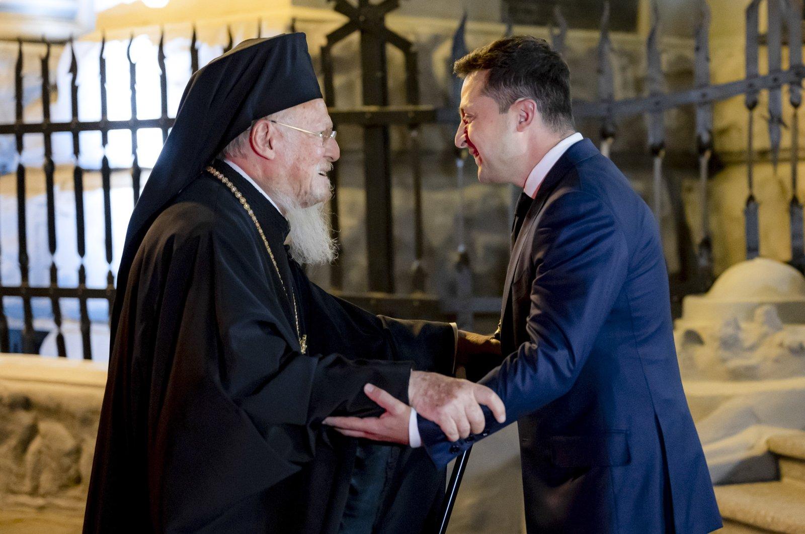 Ukrainian President Volodymyr Zelenskyy (R) greets Fener Greek Orthodox Patriarch Bartholomew I during their meeting in Kyiv, Ukraine, Aug. 21, 2021. (Ukrainian Presidential Press Office via AP)