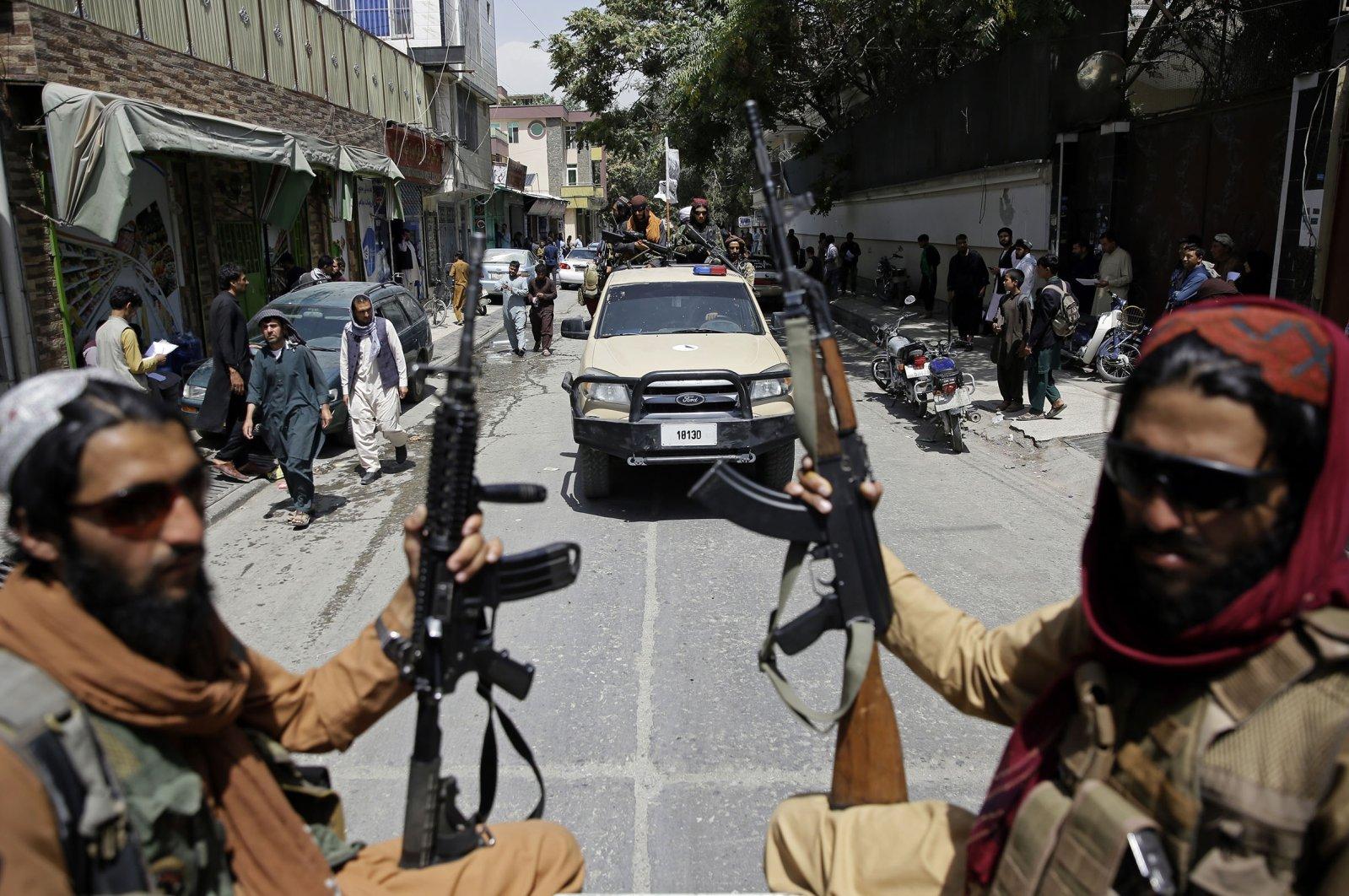 Taliban fighters patrol Kabul, Afghanistan, Aug. 19, 2021. (AP Photo)