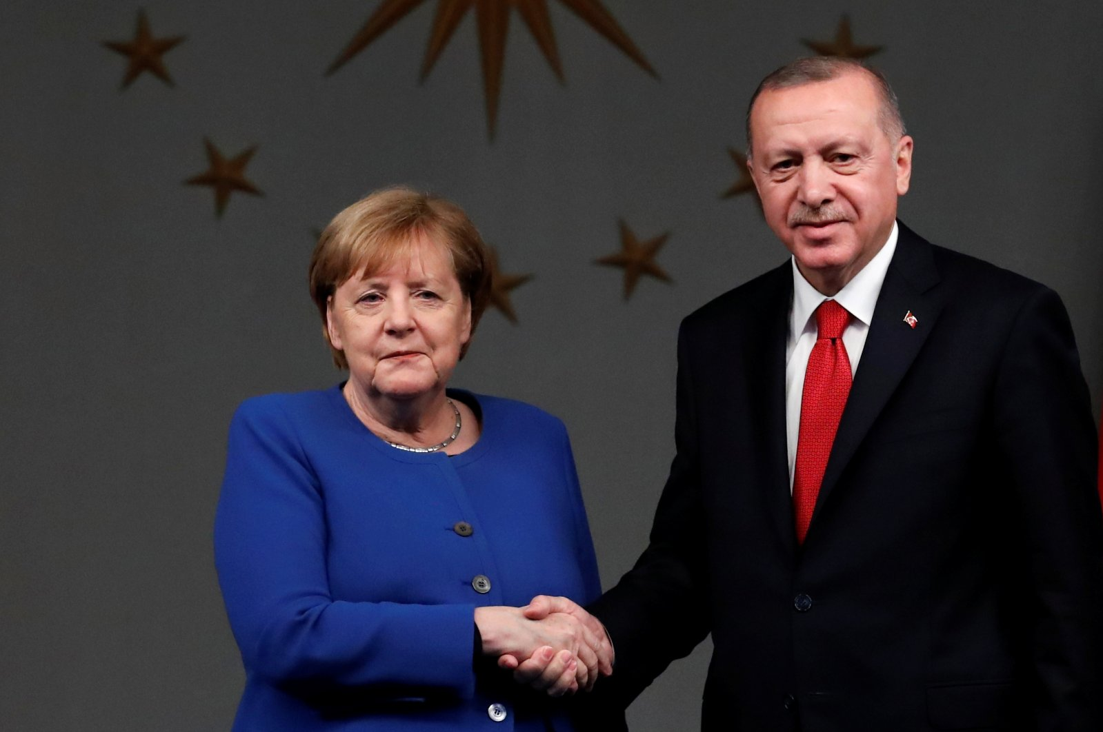 Turkish President Recep Tayyip Erdoğan and German Chancellor Angela Merkel shake hands after a joint news conference in Istanbul, Turkey, Jan. 24, 2020. (Reuters Photo)