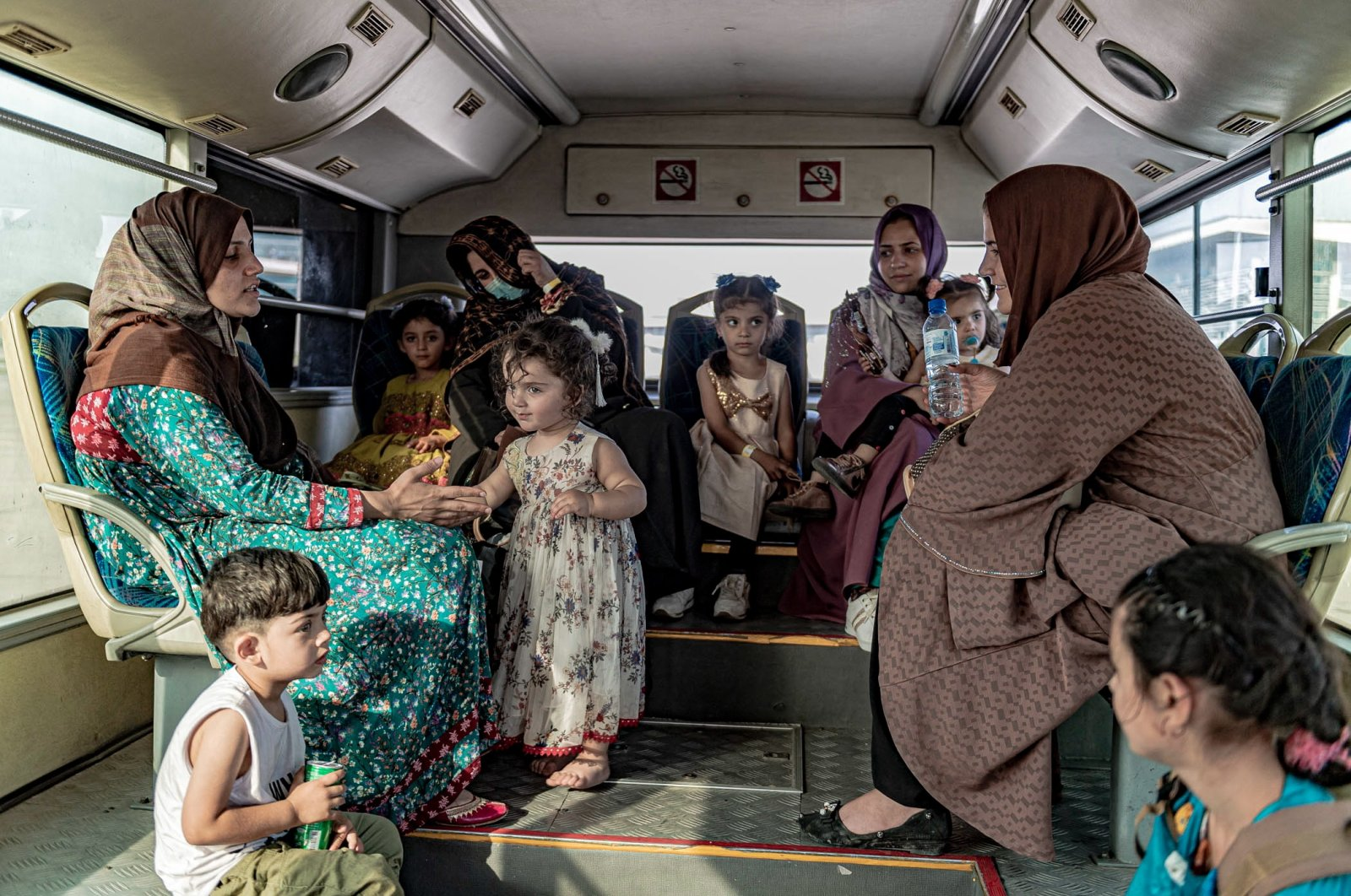 An Afghan family arrives at Islamabad Airport after their evacuation from Kabul by Belgian forces called the Operation Red Kite, Islamabad, Pakistan, Aug. 20, 2021. (Belgian Defense Ministry via EPA)