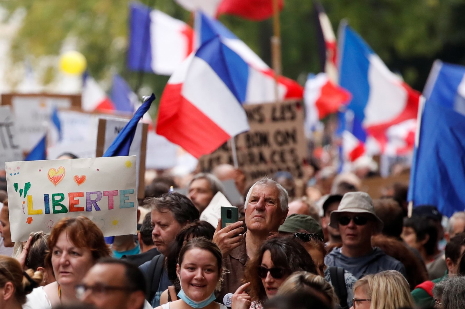 Protesters attend a demonstration against France's restrictions, including a compulsory health pass, to fight the COVID-19 outbreak, in Paris, France, Aug. 21, 2021. (Reuters Photo)