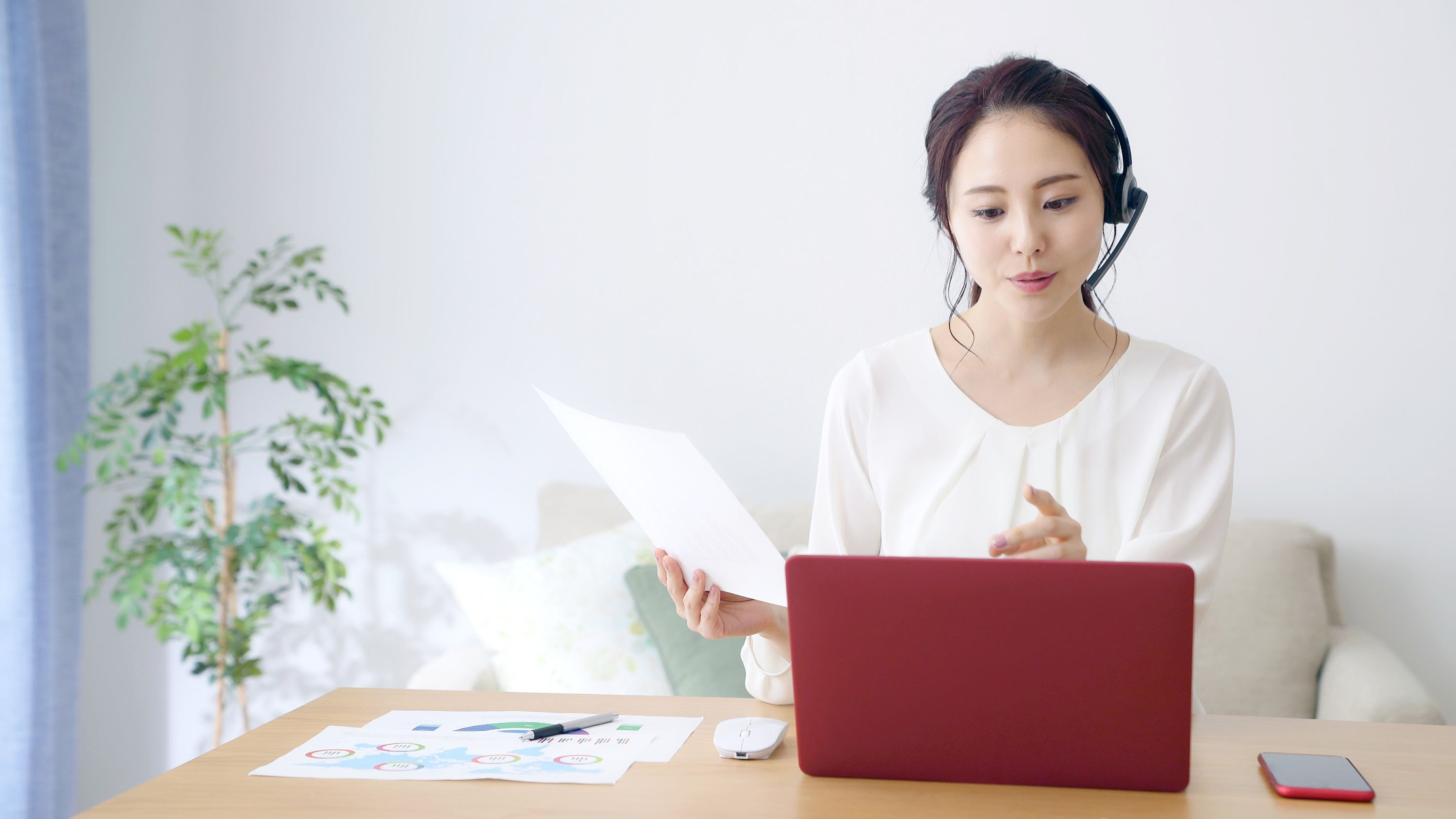 A remote worker works from home with a laptop. (Shutterstock Photo)
