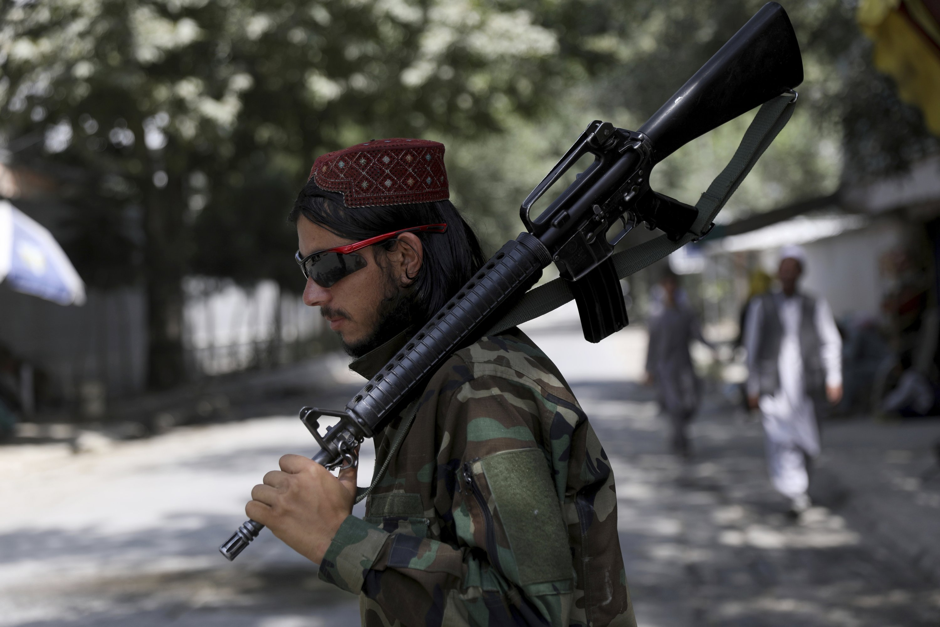A Taliban fighter stands guard at a checkpoint in the Wazir Akbar Khan neighborhood in the city of Kabul, Afghanistan, Aug. 22, 2021. (AP Photo)