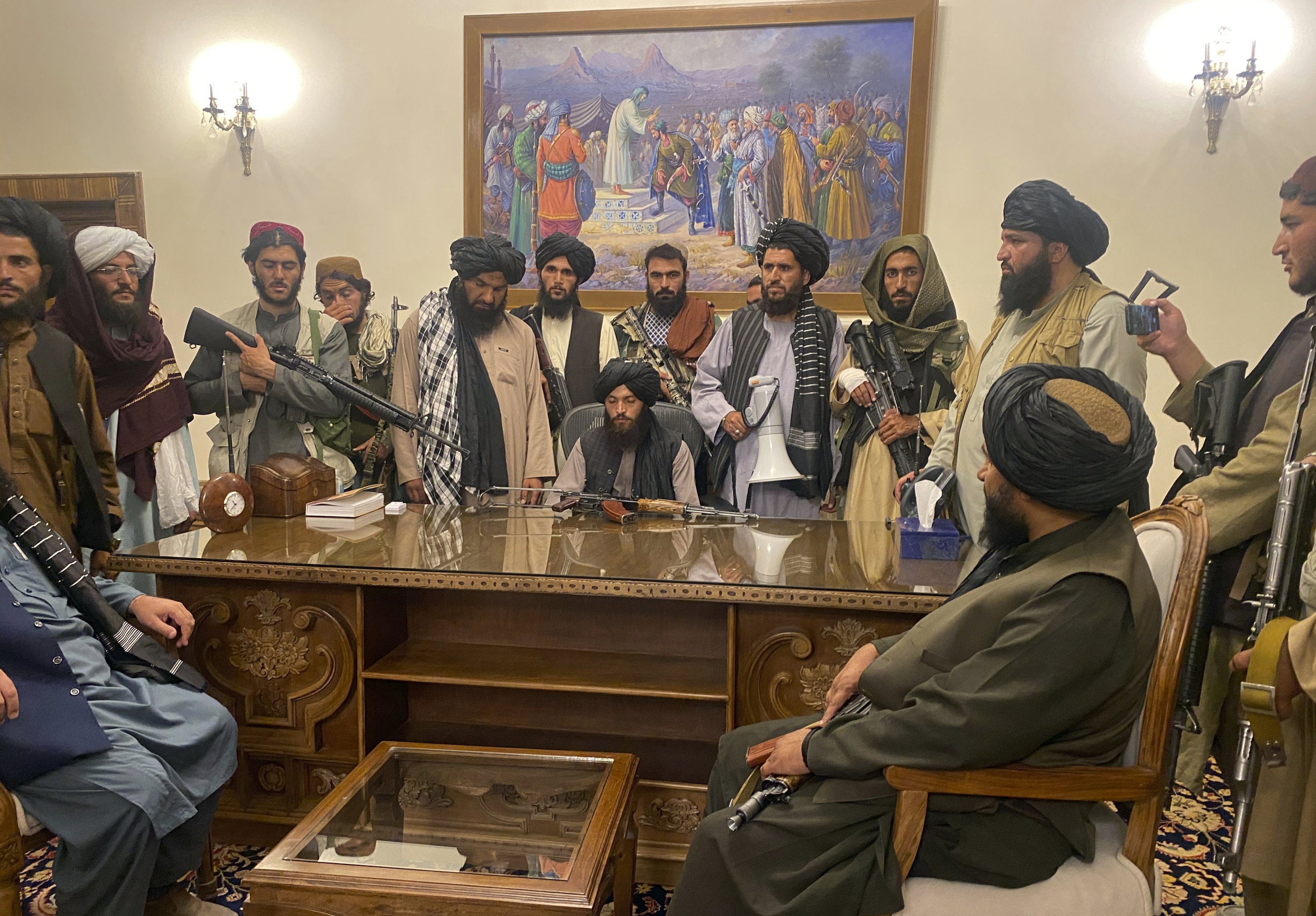 Taliban fighters take control of the Afghan presidential palace after President Ashraf Ghani fled the country, Kabul, Afghanistan, Aug. 15, 2021. (AP Photo)