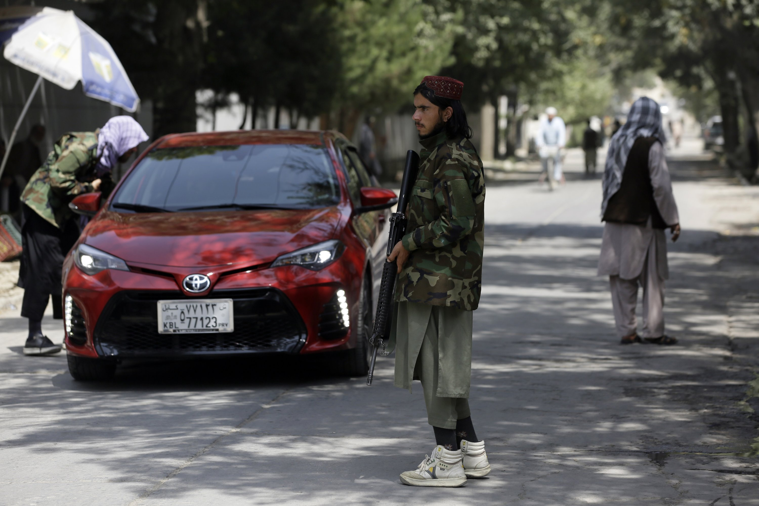 Taliban fighters search a vehicle at a checkpoint on a road in the Wazir Akbar Khan neighborhood in Kabul, Afghanistan, Aug. 22, 2021. (AP Photo)