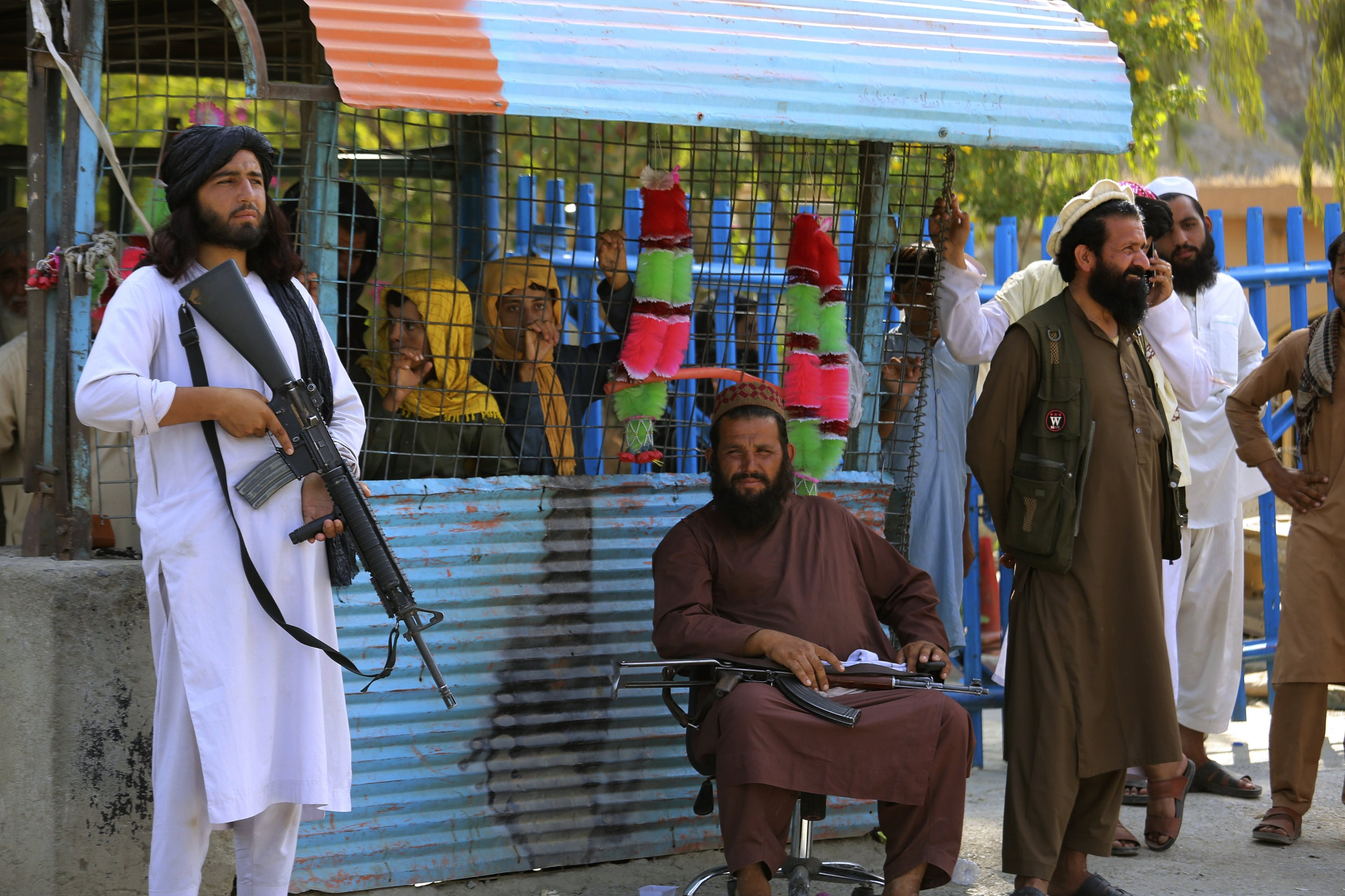 Taliban fighters stand guard on their side at a border crossing point between Pakistan and Afghanistan, in Torkham, Khyber district, Pakistan, Saturday, Aug. 21, 2021. (AP Photo)
