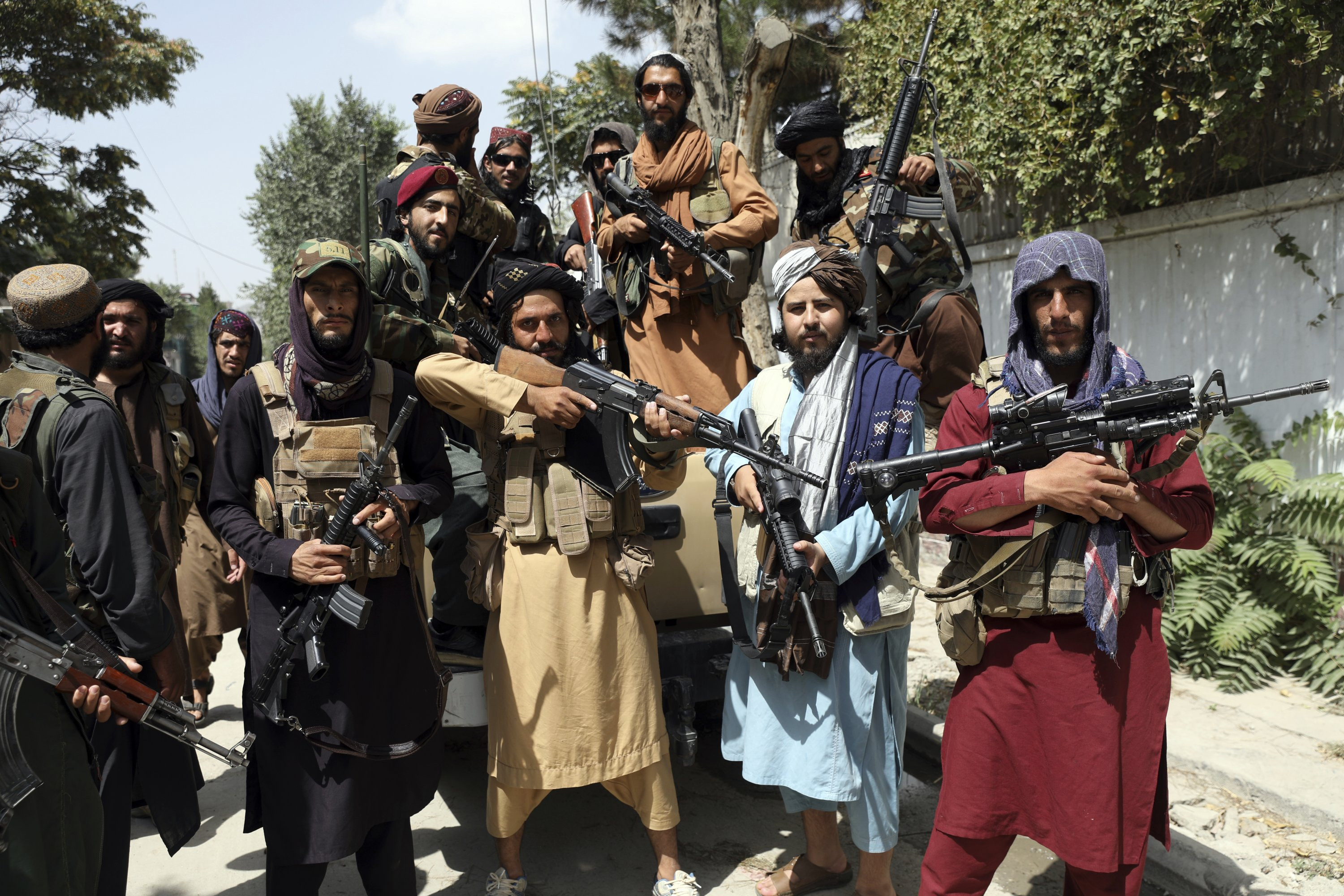 Taliban fighters pose for a photograph in Kabul, Afghanistan, Aug. 19, 2021. (AP Photo)
