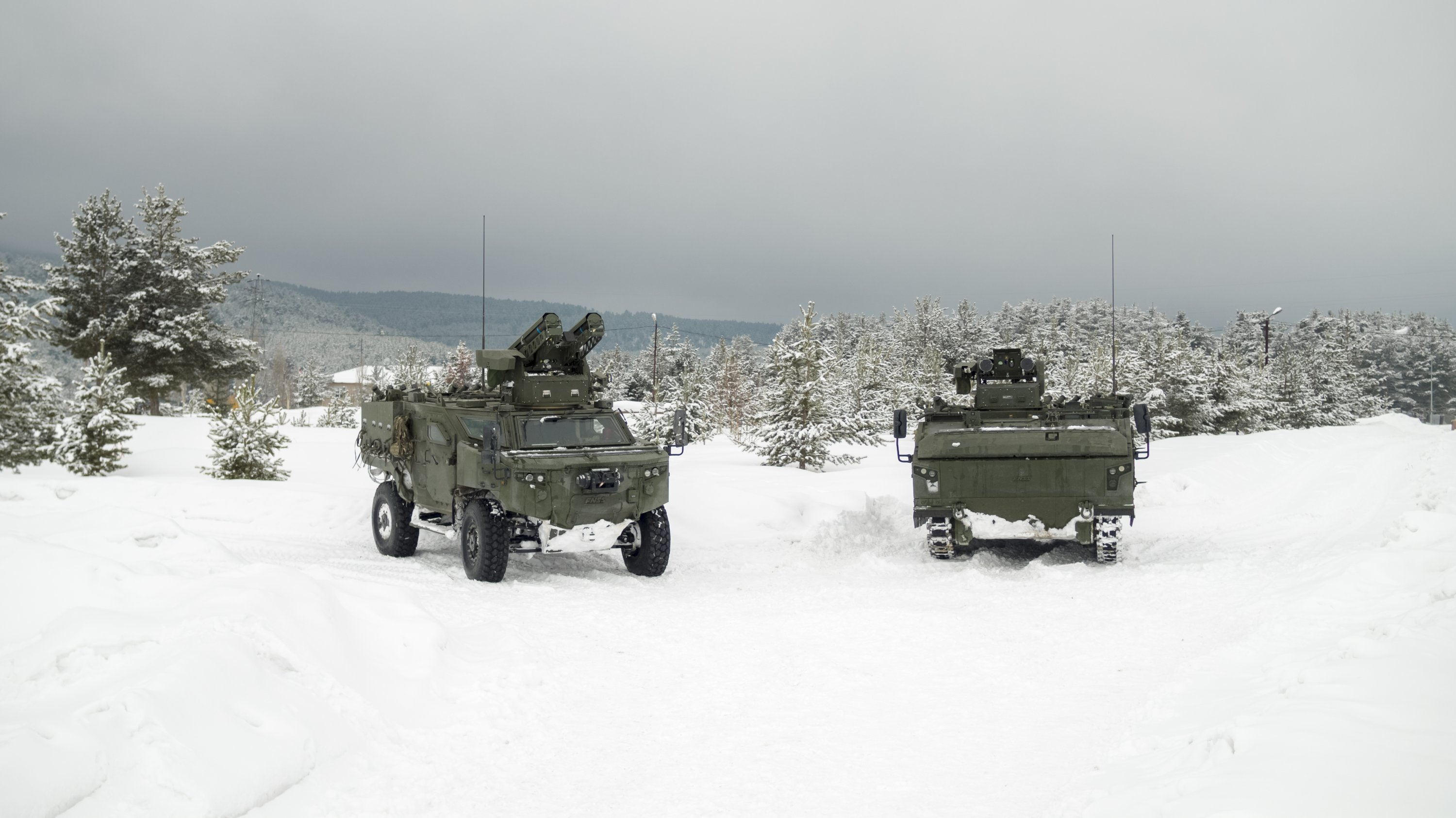 Kaplan (R) and Pars (L) 4x4 weapon carrier vehicles seen in this photo provided on Aug. 21, 2021. (Courtesy of FNSS)