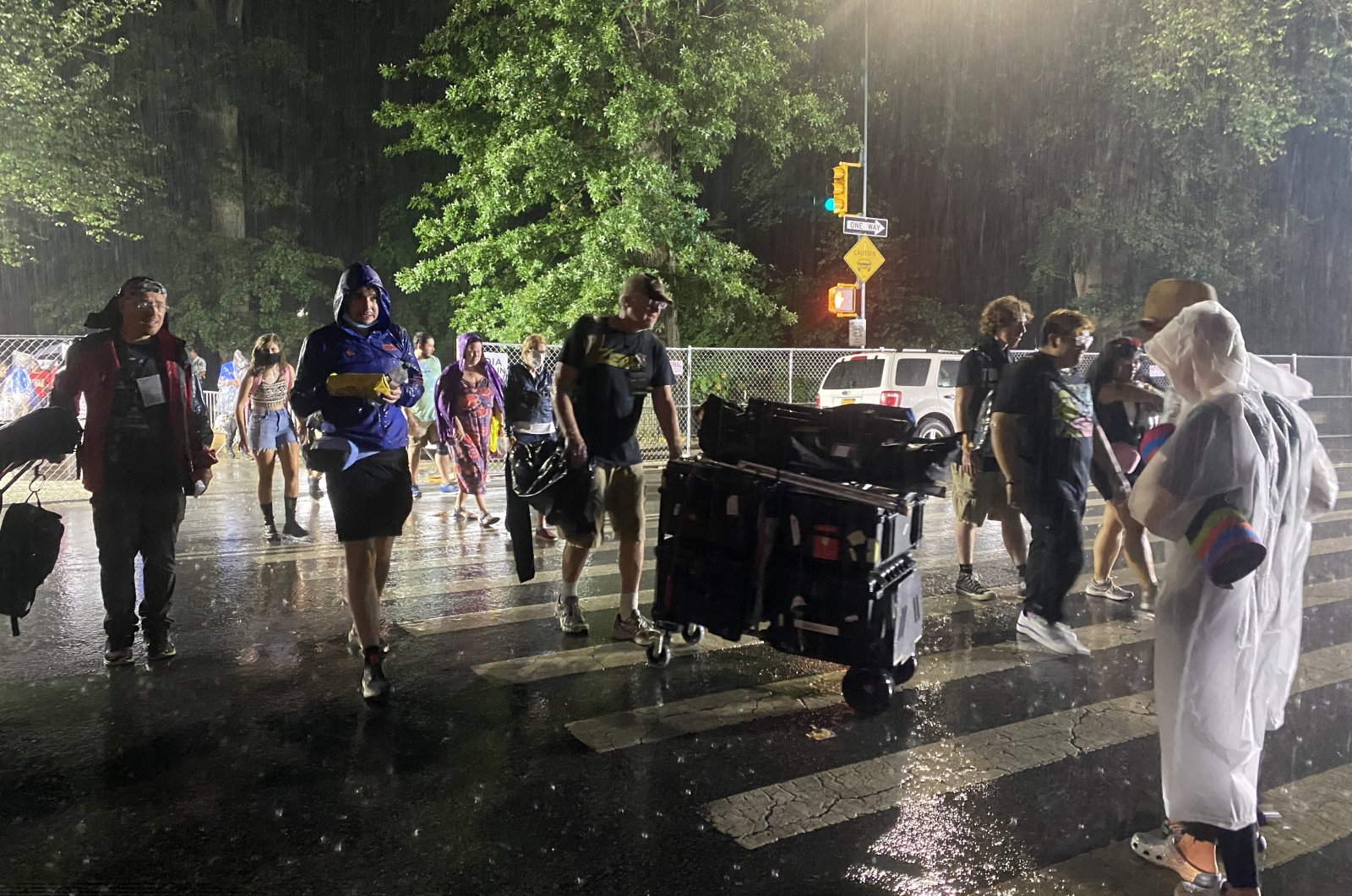 People are seen leaving a concert amid the Hurricane Henri's advance into the northeastern United States on Aug. 22, 2021 (AA Photo)