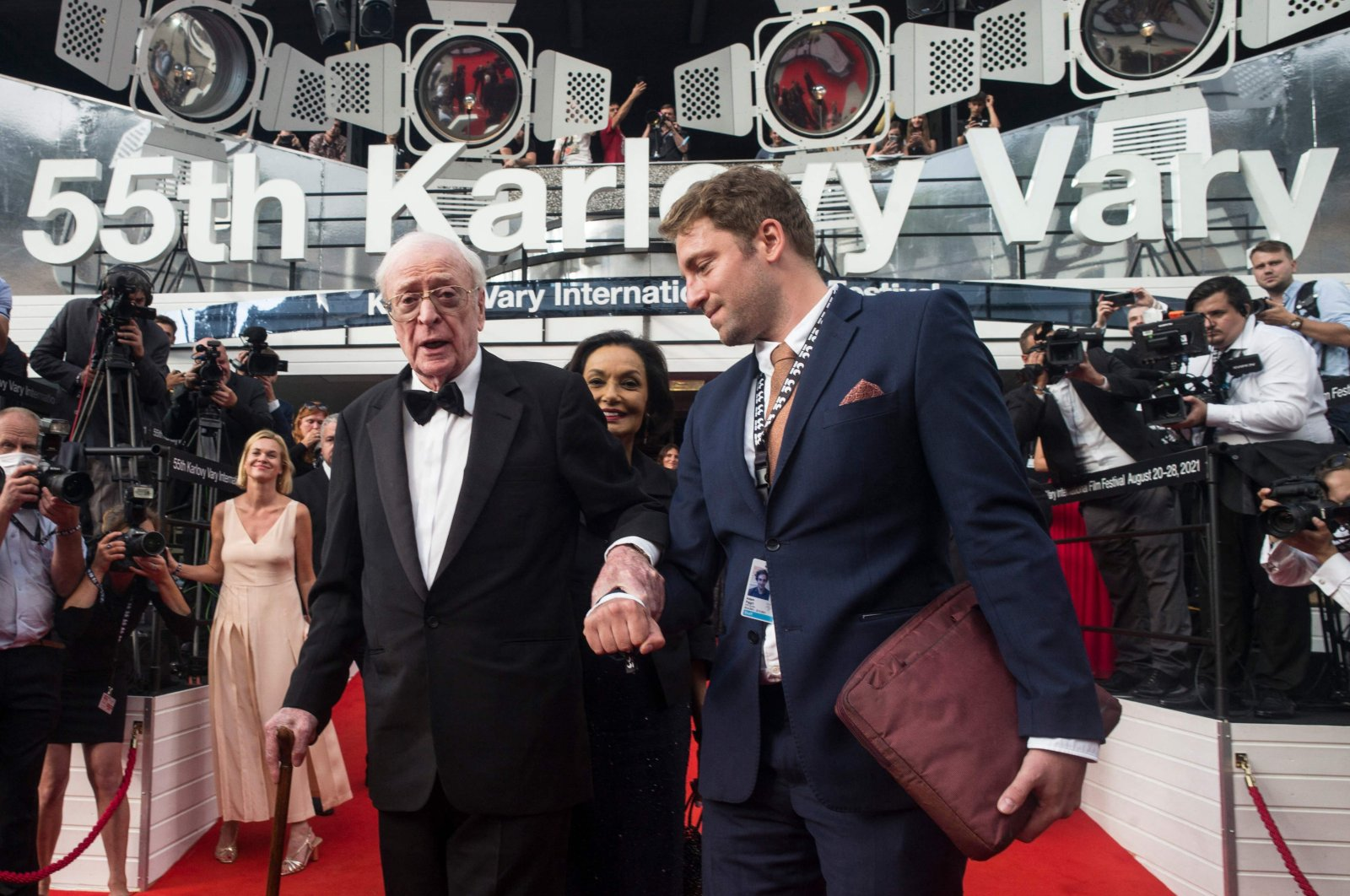 British film actor Michael Caine (L) poses on the red carpet prior to the opening of the 55th Karlovy Vary International Film Festival (KVIFF) in Karlovy Vary, Czech Republic, Aug. 20, 2021. (AFP Photo)