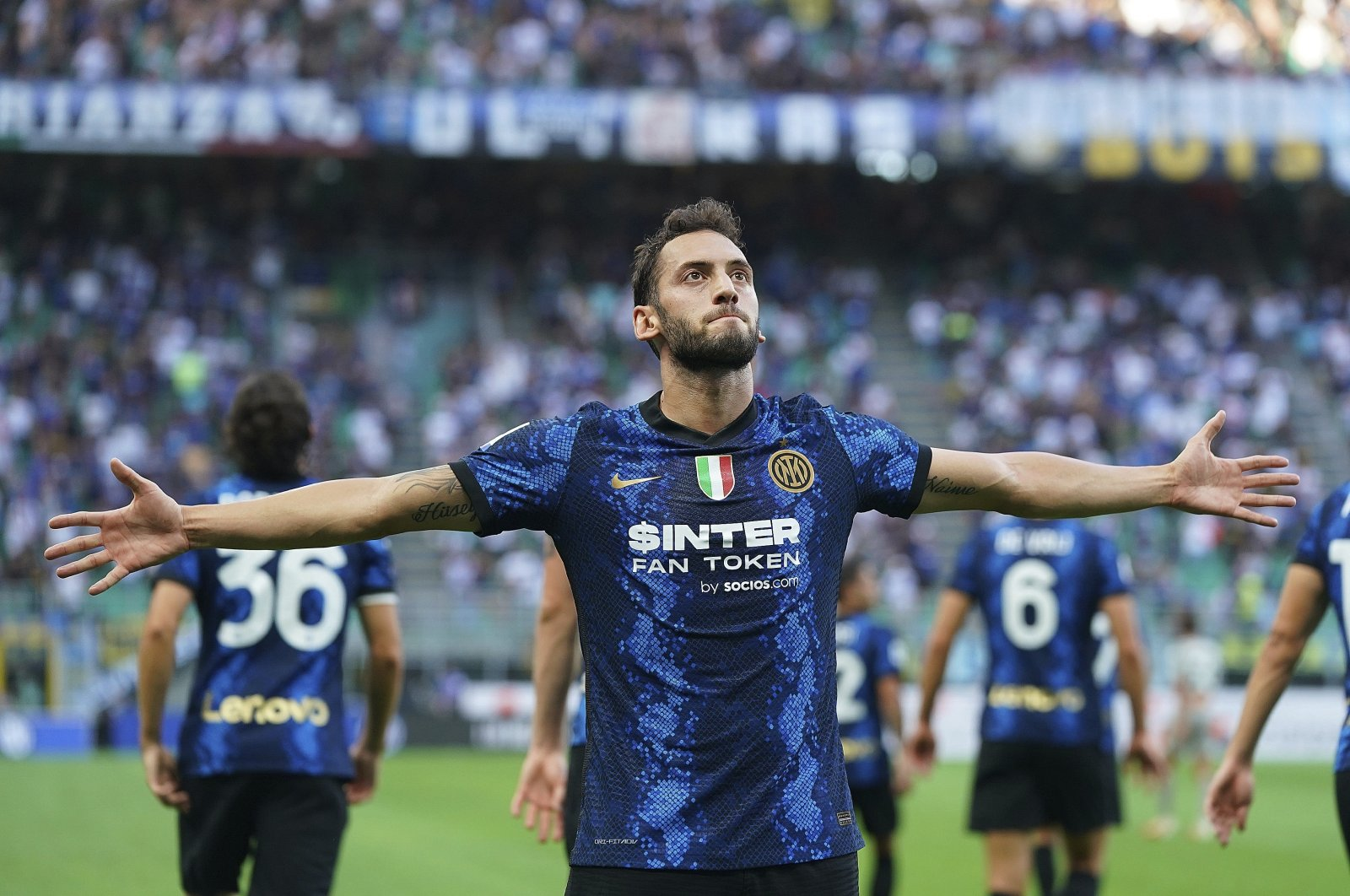 Inter Milan's Hakan Çalhanoğlu celebrates after scoring his side's 2nd goal in a Serie A match against Genoa at the San Siro, Milan, Italy, Aug. 21, 2021. (AP Photo)