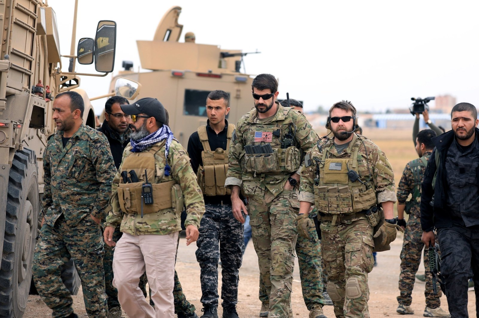 YPG terrorists and U.S. troops are seen together during a joint patrol near the Turkish border in Hassakeh, northeastern Syria, Nov. 4, 2018. (Reuters Photo)