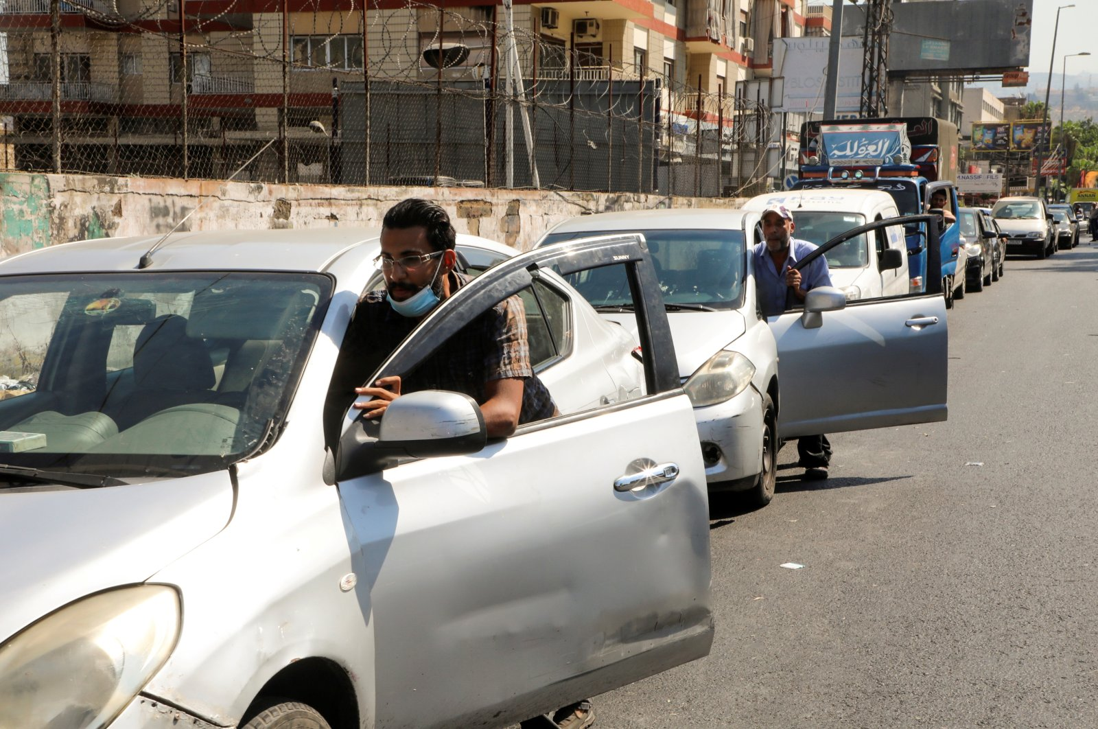 People push their cars due to a lack of fuel, near a gas station in Dora, Lebanon, Aug. 17, 2021. (Reuters Photo)