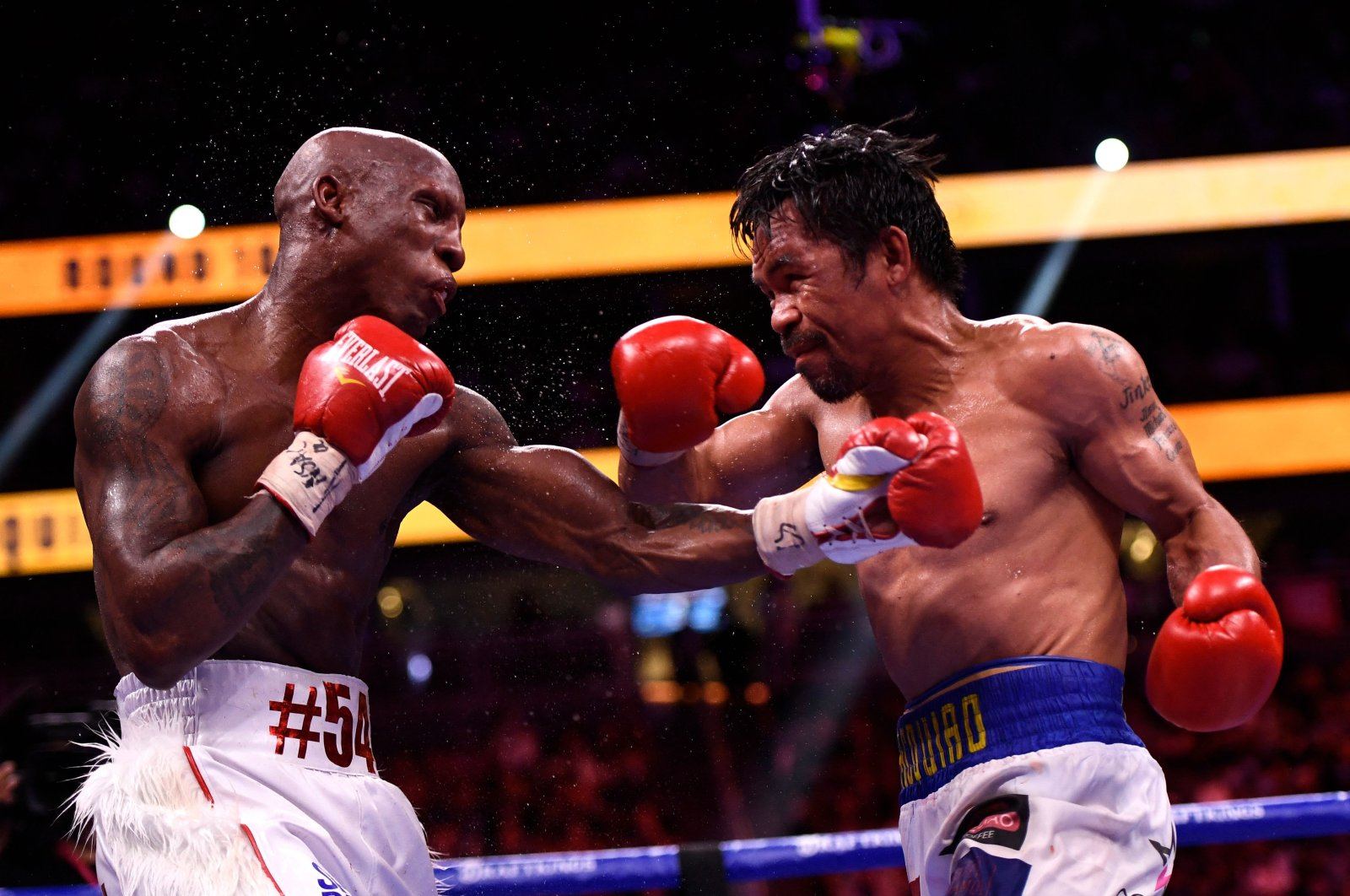 Philippines' Manny Pacquiao (R) fights against Cuba's Yordenis Ugas in the WBA Welterweight Championship boxing match at T-Mobile Arena in Las Vegas, U.S., Aug. 21, 2021. (AFP Photo)