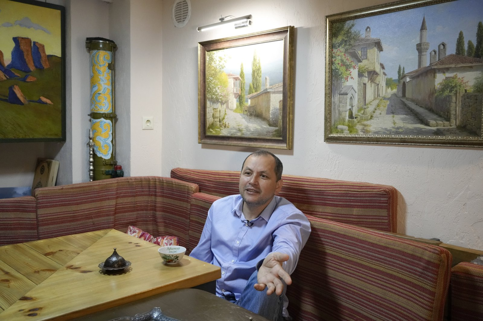 Erfan Kudusov talks during an interview with The Associated Press in Kyiv, Ukraine, Aug. 11, 2021. (AP Photo)