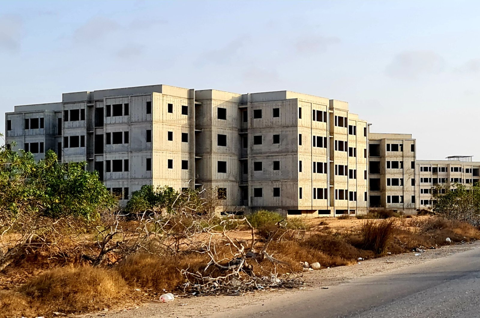A picture taken Aug. 13, 2021, shows unfinished residential buildings after their construction was halted in 2011, in the coastal city of Tajura, east of the capital Tripoli, Libya. (AFP Photo)