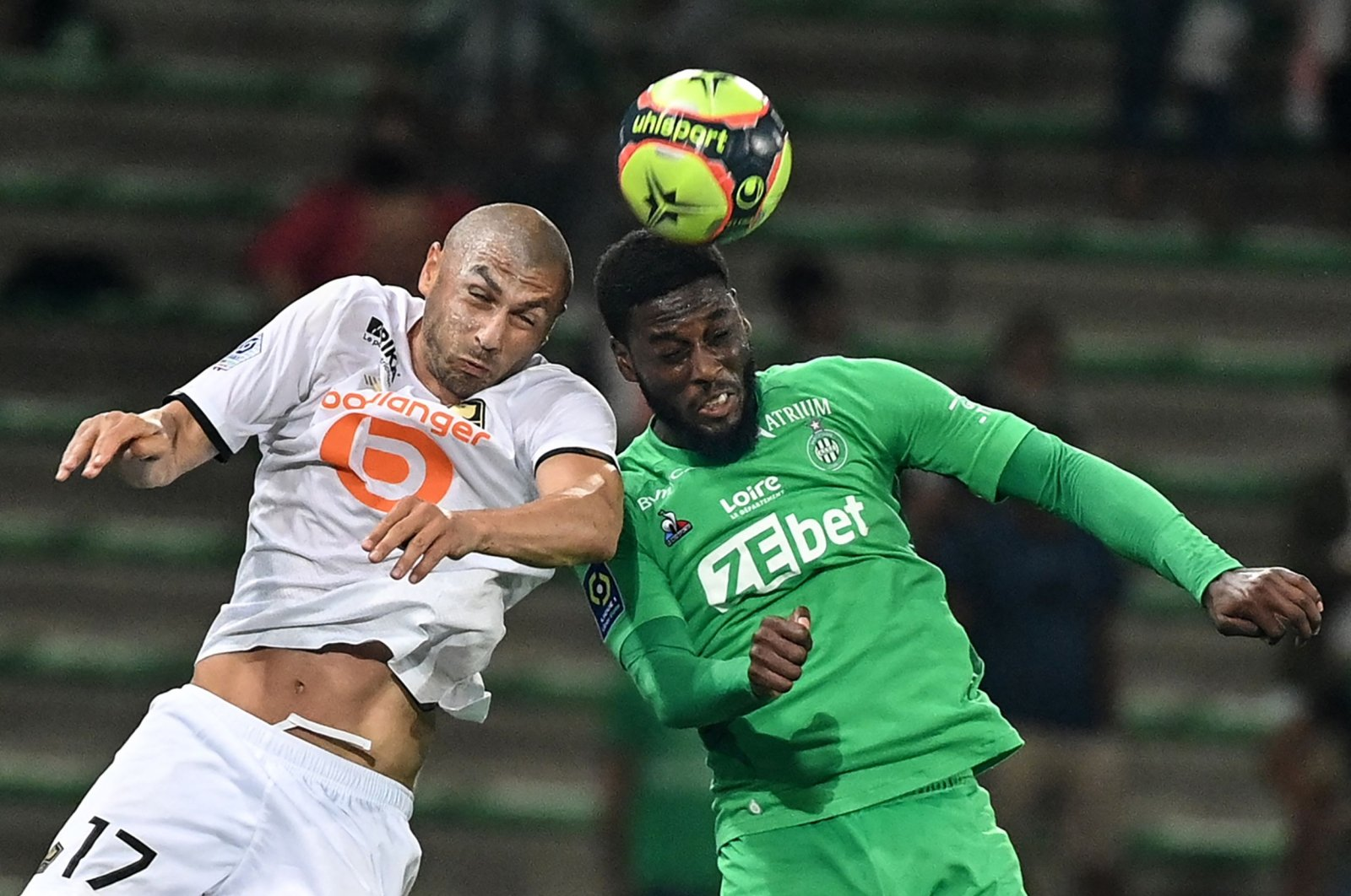 Lille's Turkish forward Burak Yılmaz (L) fights for the ball in the air with Saint-Etienne's French forward Jean-Philippe Krasso during a French L1 match, Saint-Etienne, France, Aug. 21, 2021.(AFP Photo)