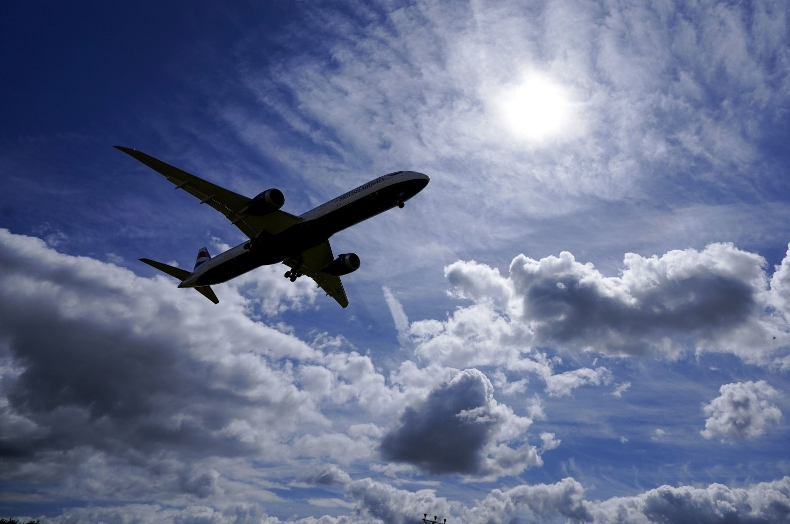 A plane preparing to land on the southern runway at London's Heathrow Airport, U.K., July 29, 2021. (AP Photo)