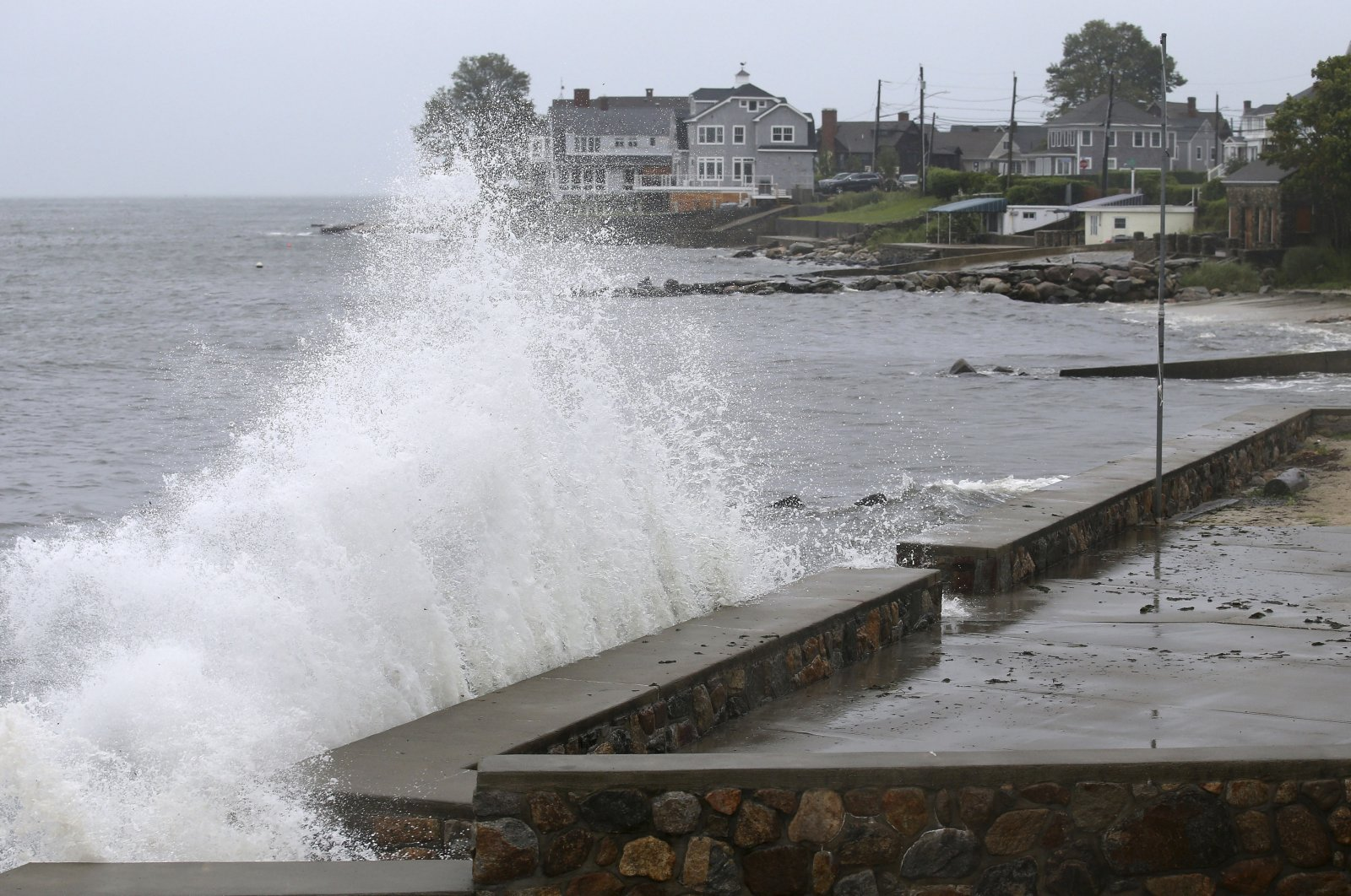 Waves crash against the sea wall along Pequot Avenue in New London, Conn. U.S., as Tropical Storm Henri approaches, Aug. 22, 2021. (AP Photo)